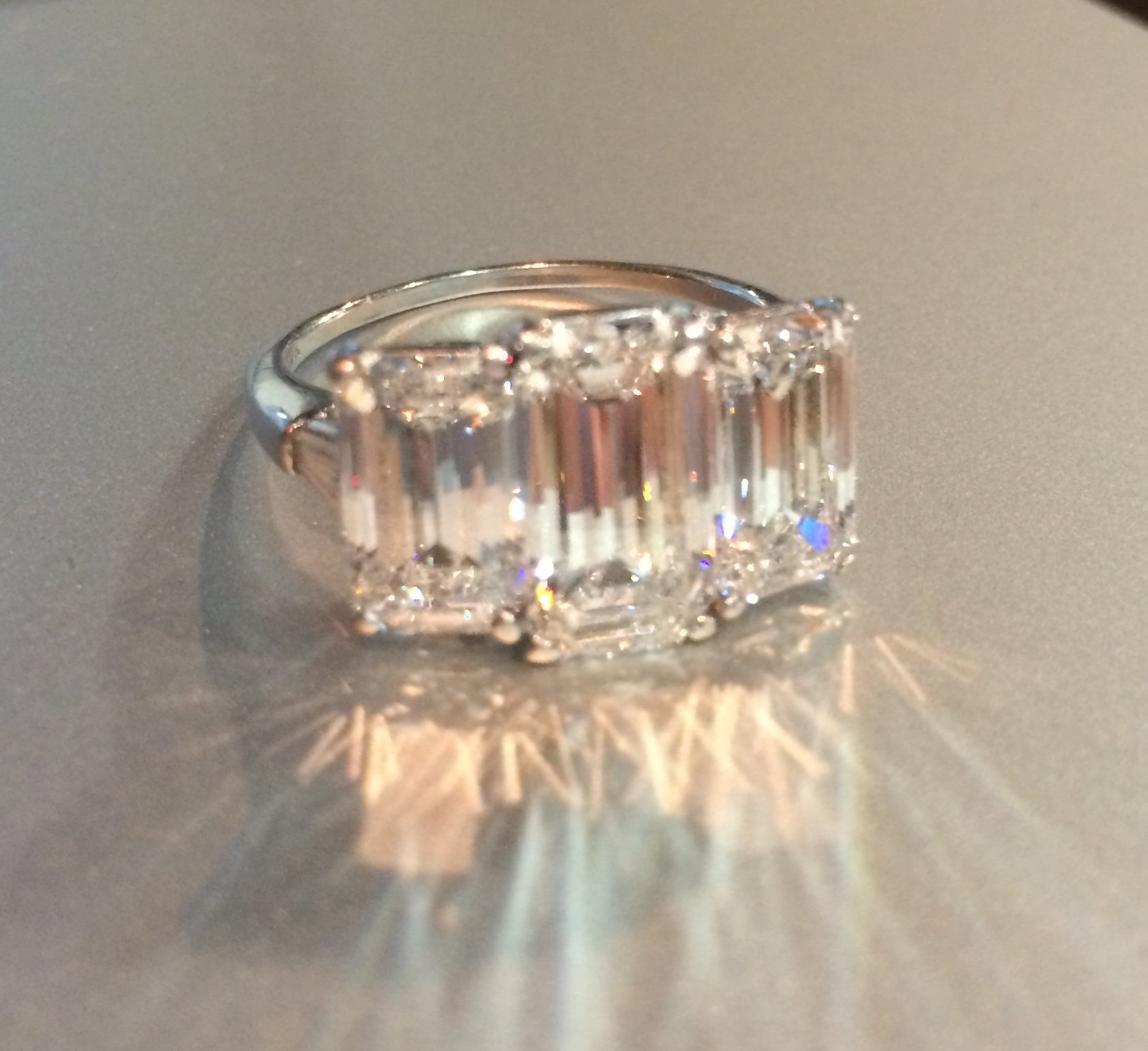 An emerald cut Harry Winston diamond ring.