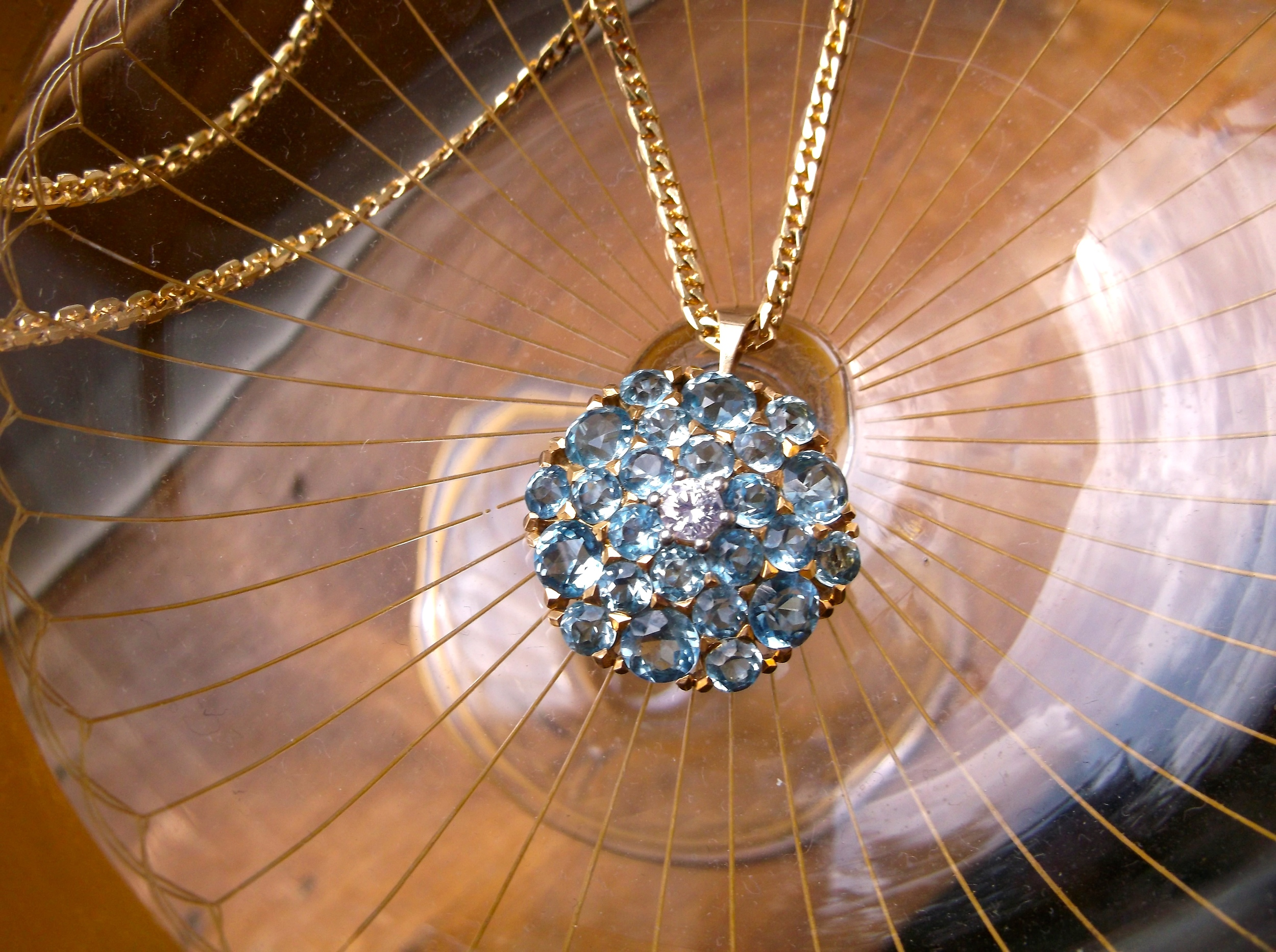 SOLD - Mesmerizing aquamarine pendant with a diamond in the center set in yellow gold.