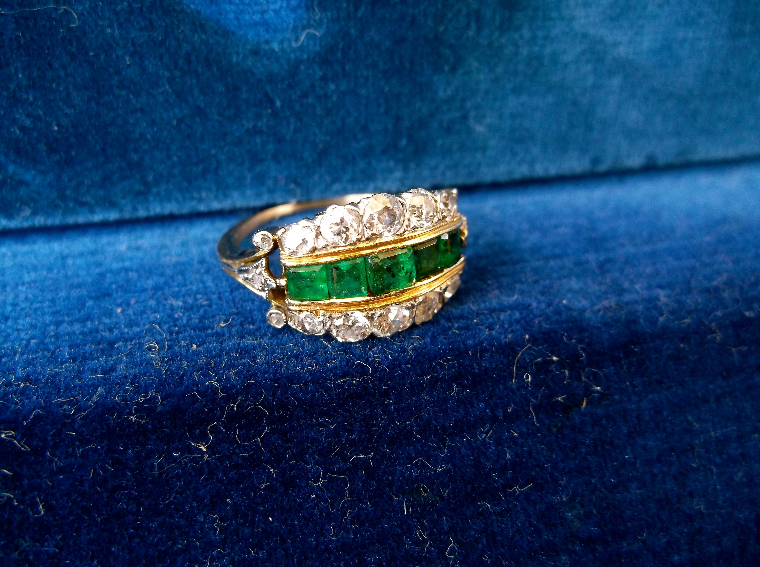 Edwardian era Old European cut diamond and emerald ring set in platinum on yellow gold.