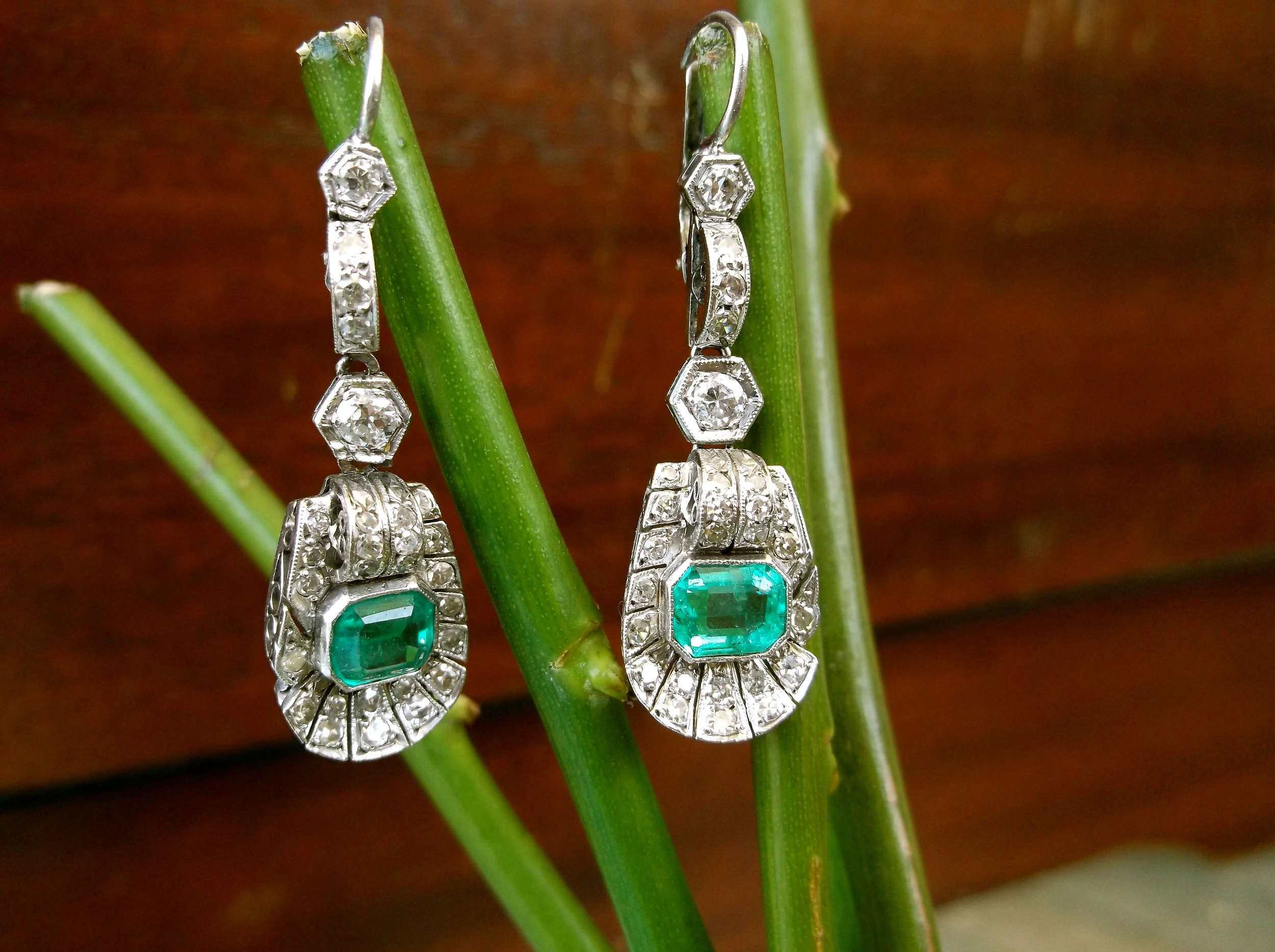SOLD - An Argentinian find! Art Deco diamond (1.05 carats total weight) and emerald earrings (each emerald is 0.85 carats) set in platinum.