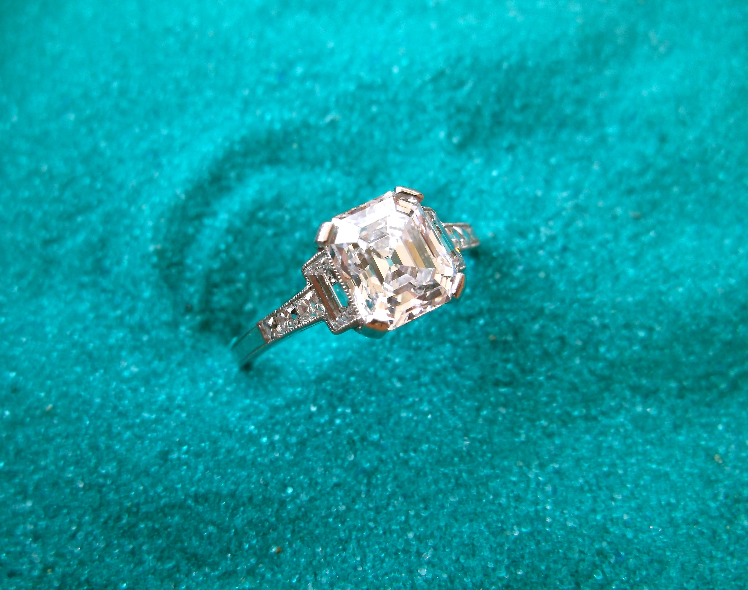 SOLD - Incredible Tiffany & Co. 1.67 carat, D color, asscher cut diamond set in a stunning Tiffany & Co. diamond and platinum mounting.