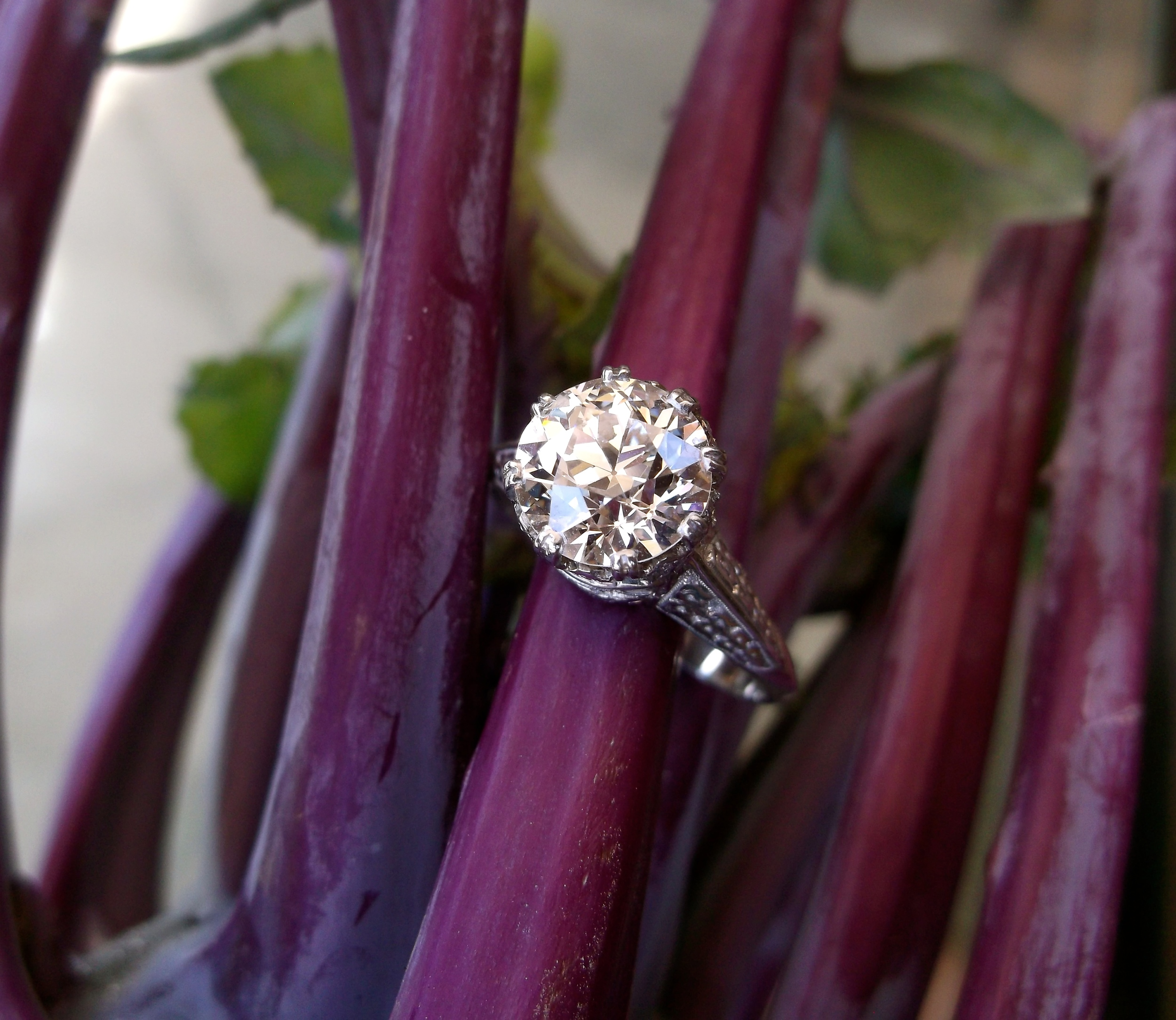 SOLD - Exquisite 1920's 2.11 carat Old European cut diamond set in a beautifully detailed platinum mounting.