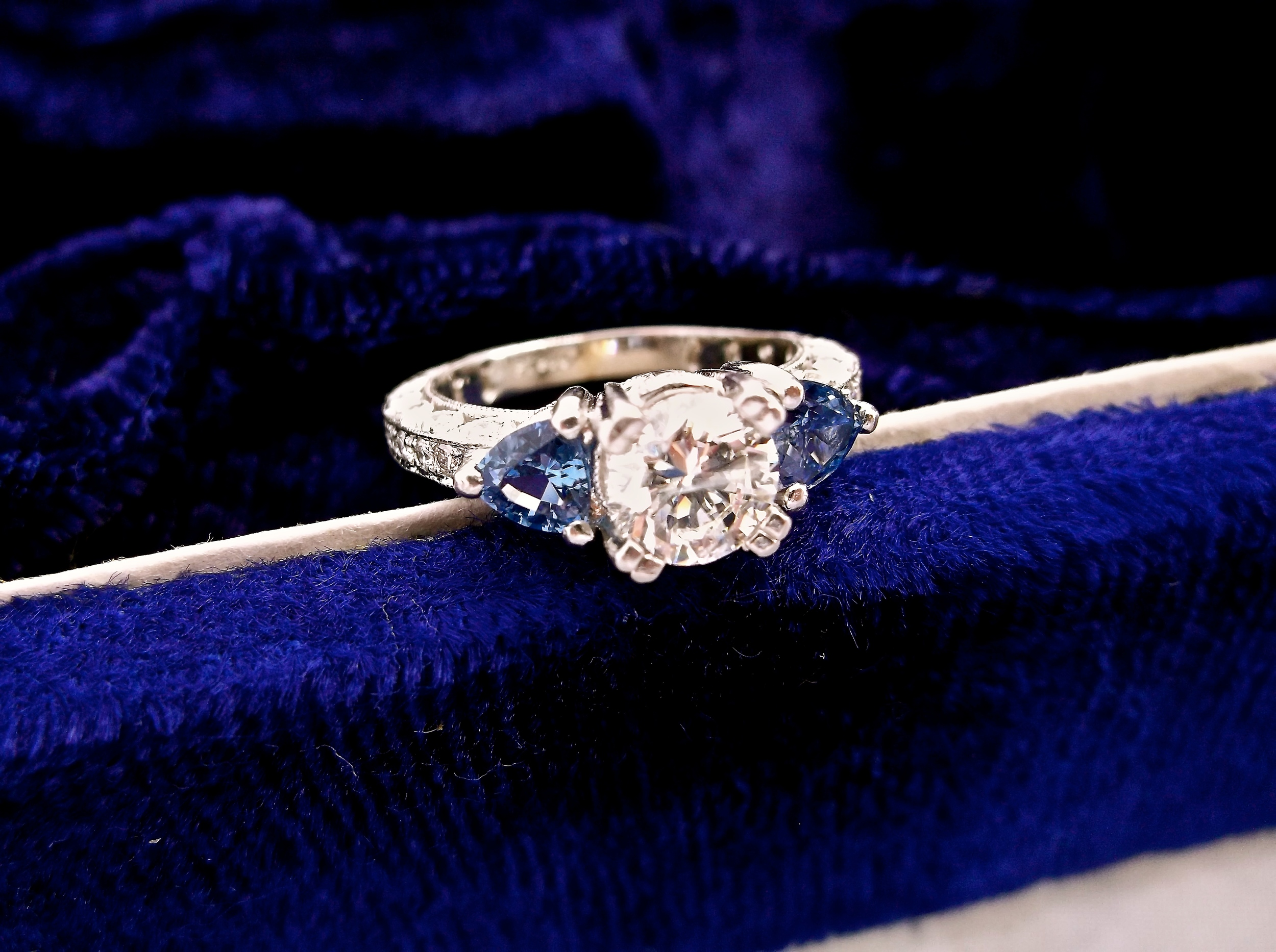 SOLD - Enchanting 0.94 carat diamond set in platinum with a sapphire on each side.
