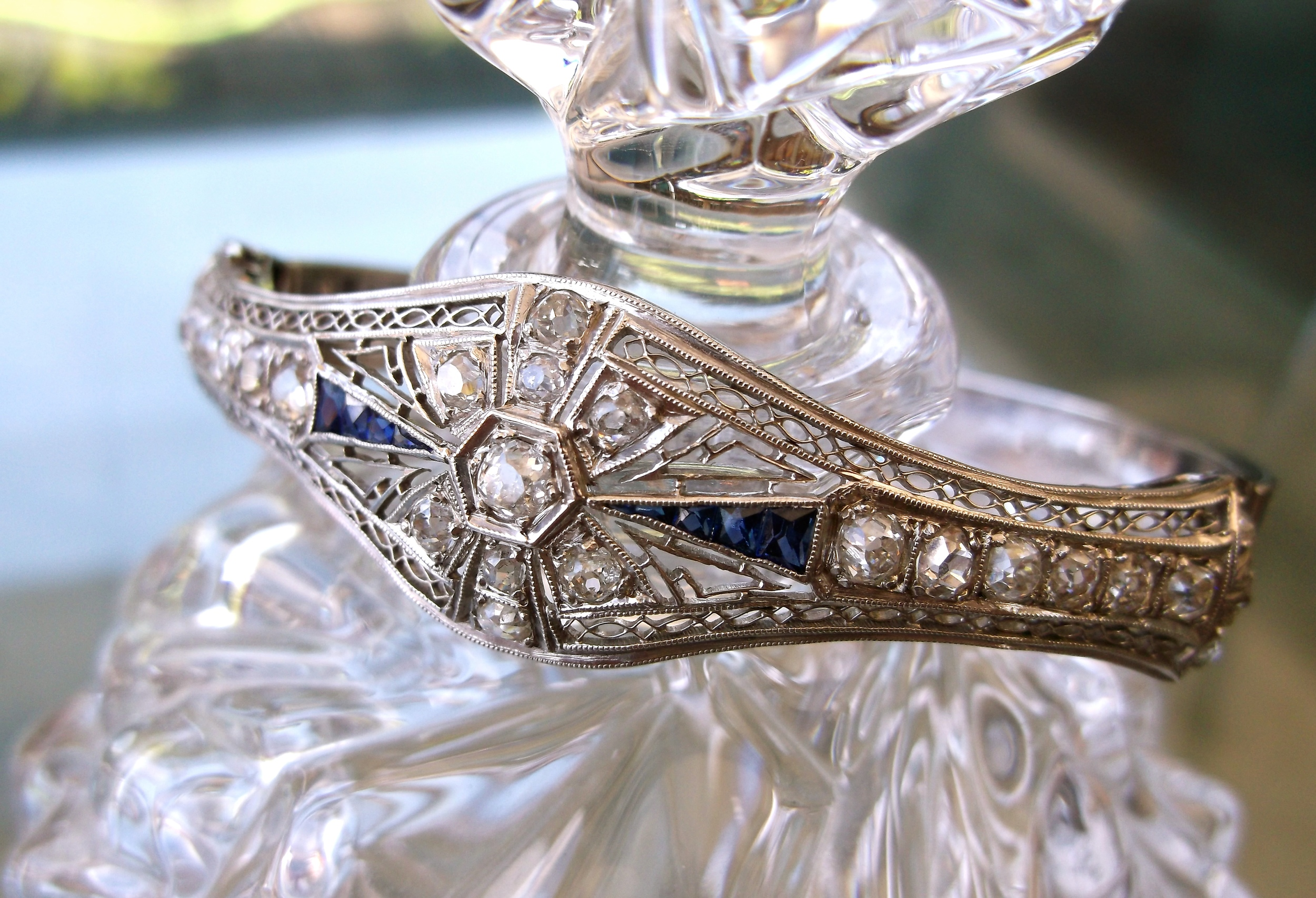 SOLD - Gorgeous Art Deco diamond and sapphire bangle bracelet set in white gold.