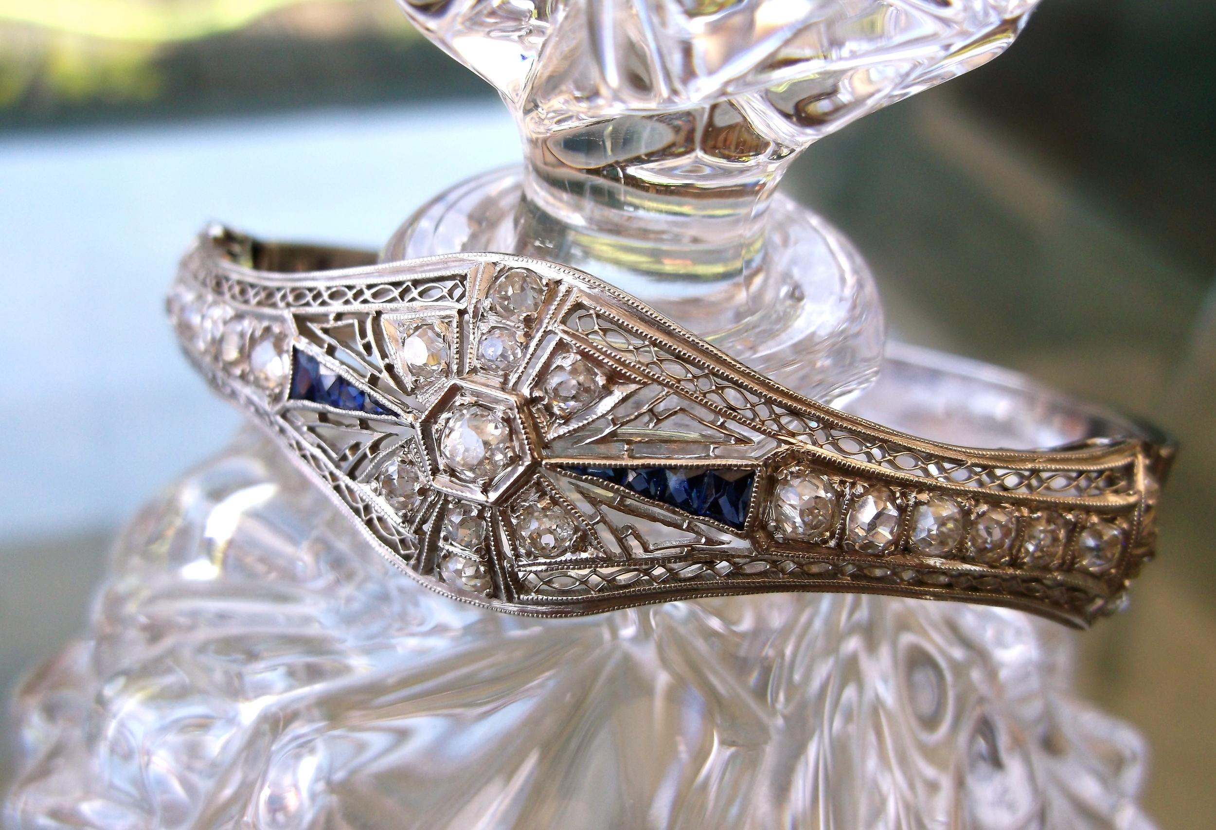 SOLD -Gorgeous Art Deco diamond and sapphire bangle bracelet set in white gold.