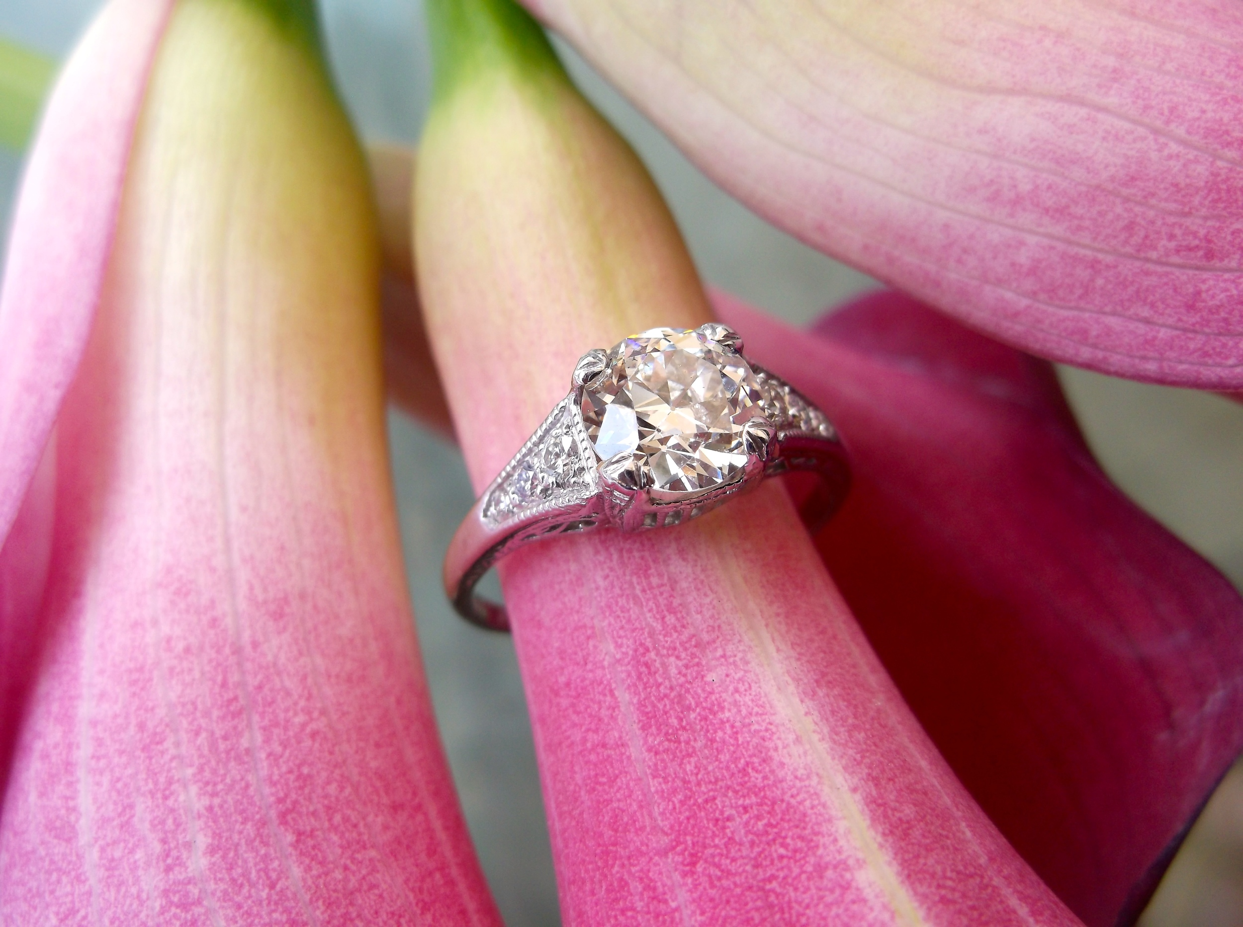 SOLD - Exquisite 1920's 1.30 carat Old European cut diamond set in a beautiful diamond and platinum mounting.