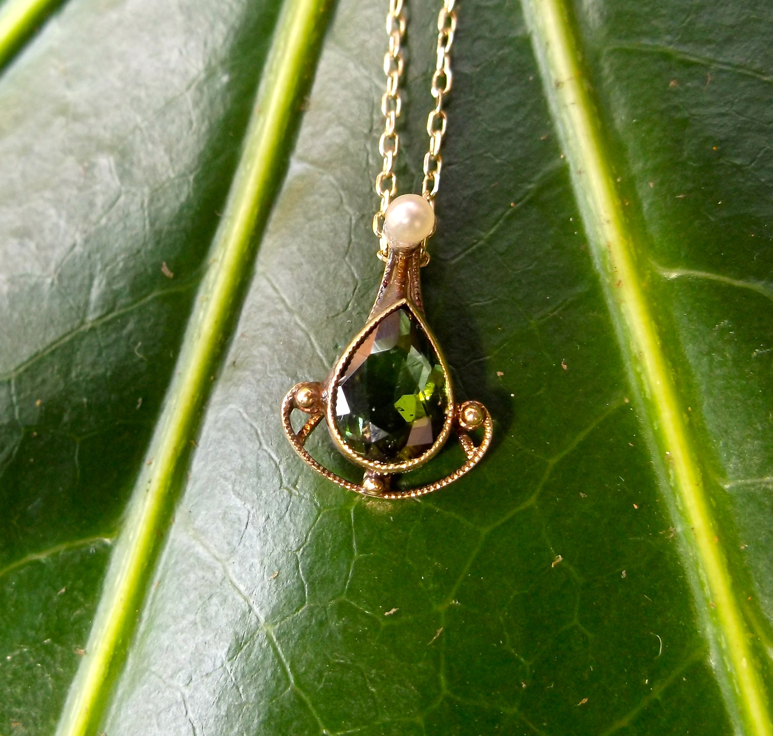 For August: Late Victorian Era green tourmaline, pearl and yellow gold pendant.