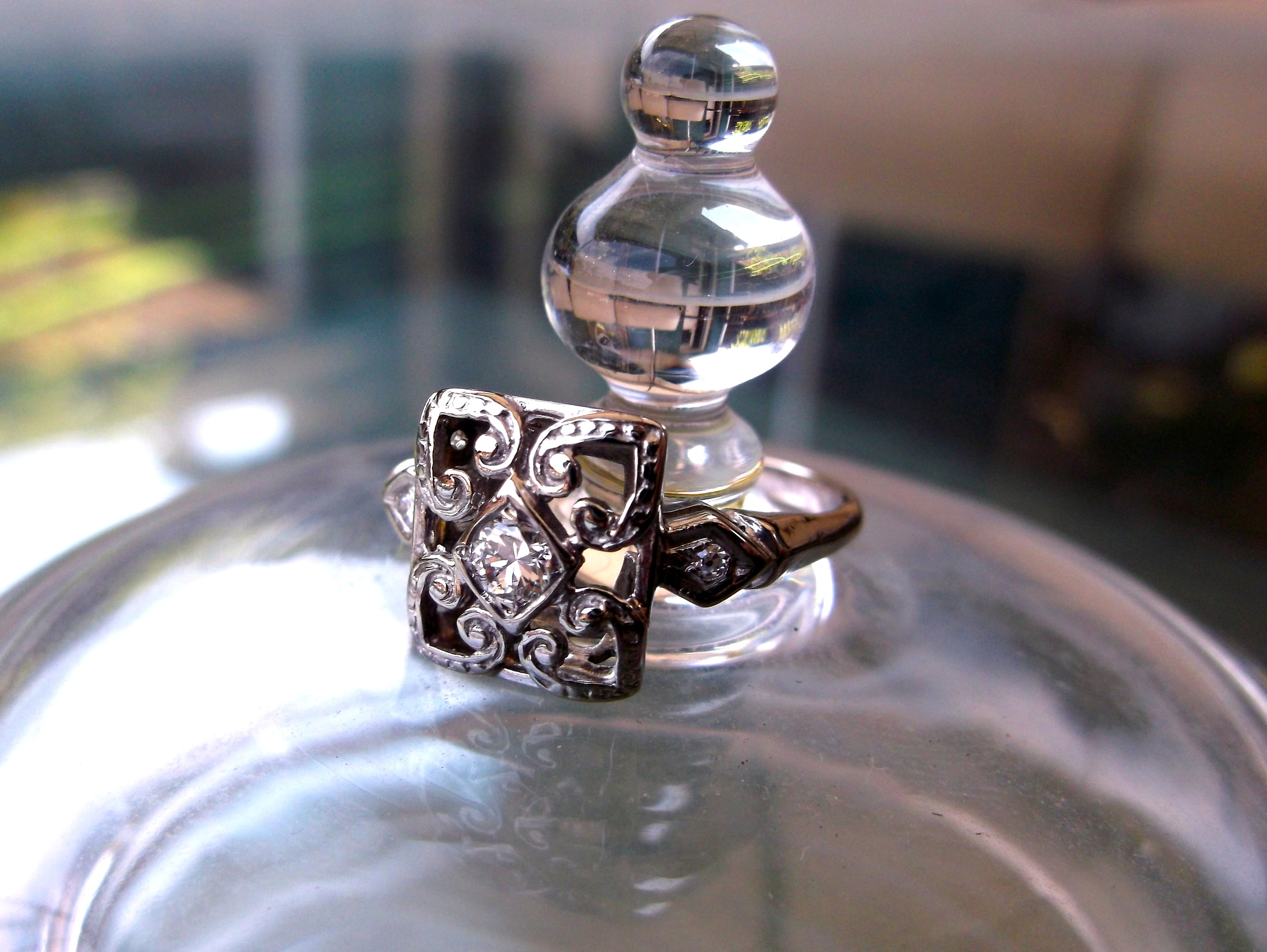 SOLD - Sweet Art Deco ring with a 0.10 carat Old European cut diamond in the center set in white gold.
