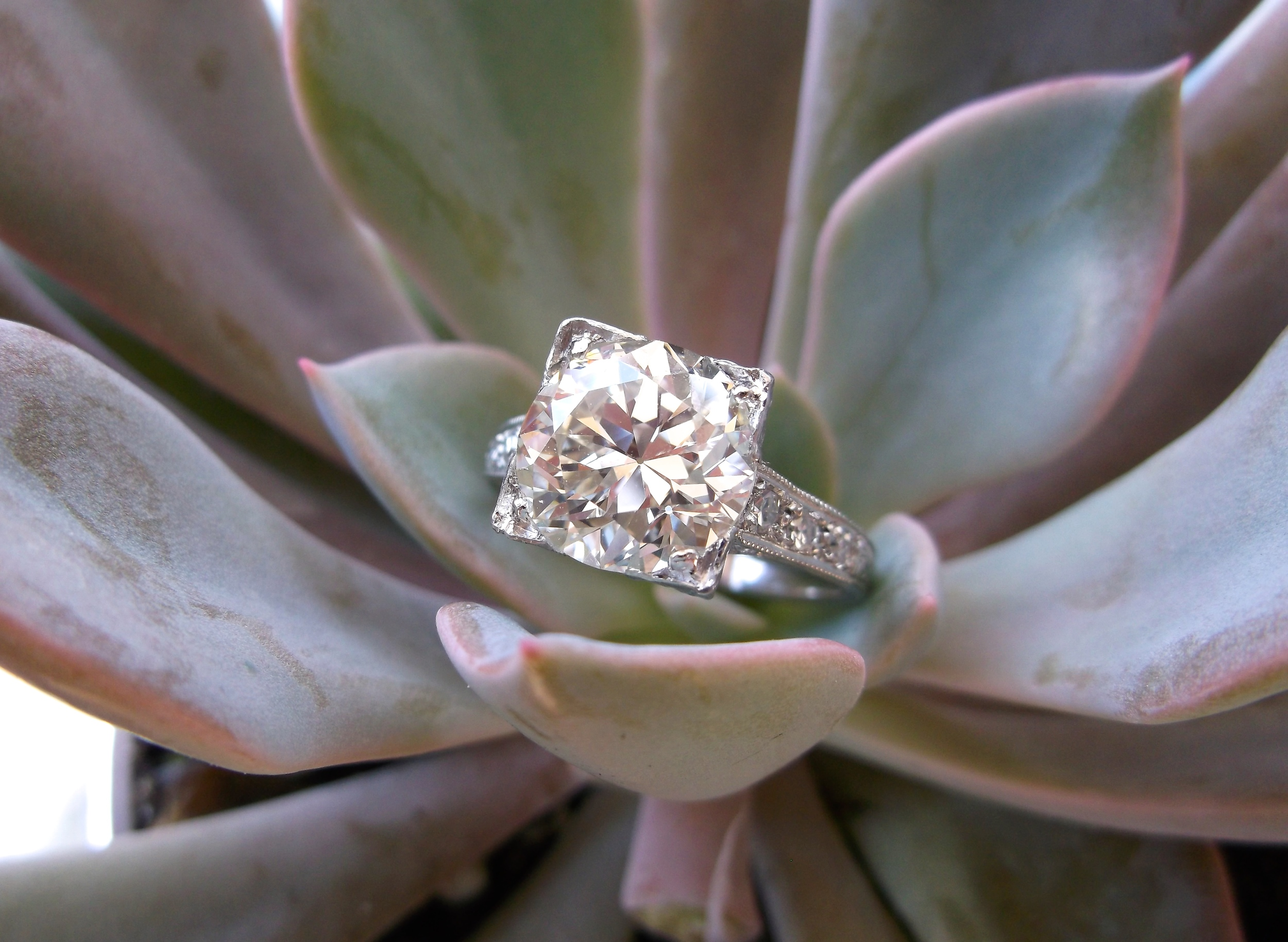 SOLD - An Art Deco knockout! 3.04 carat Old European cut diamond set in a diamond and platinum mounting.