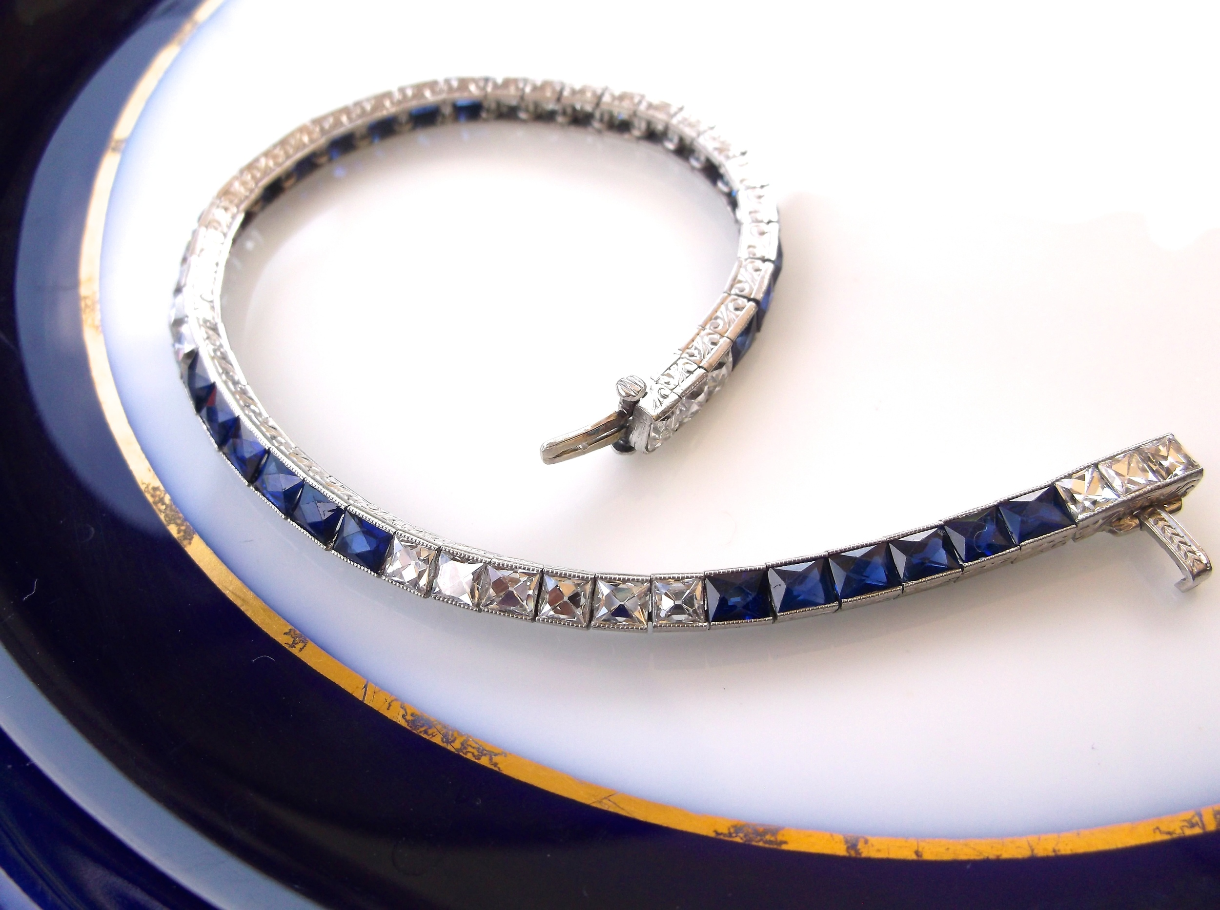 SOLD - Stunning 1920's swiss cut diamond and synthetic sapphire bracelet set in platinum with 3.60 carats total weight in diamonds.