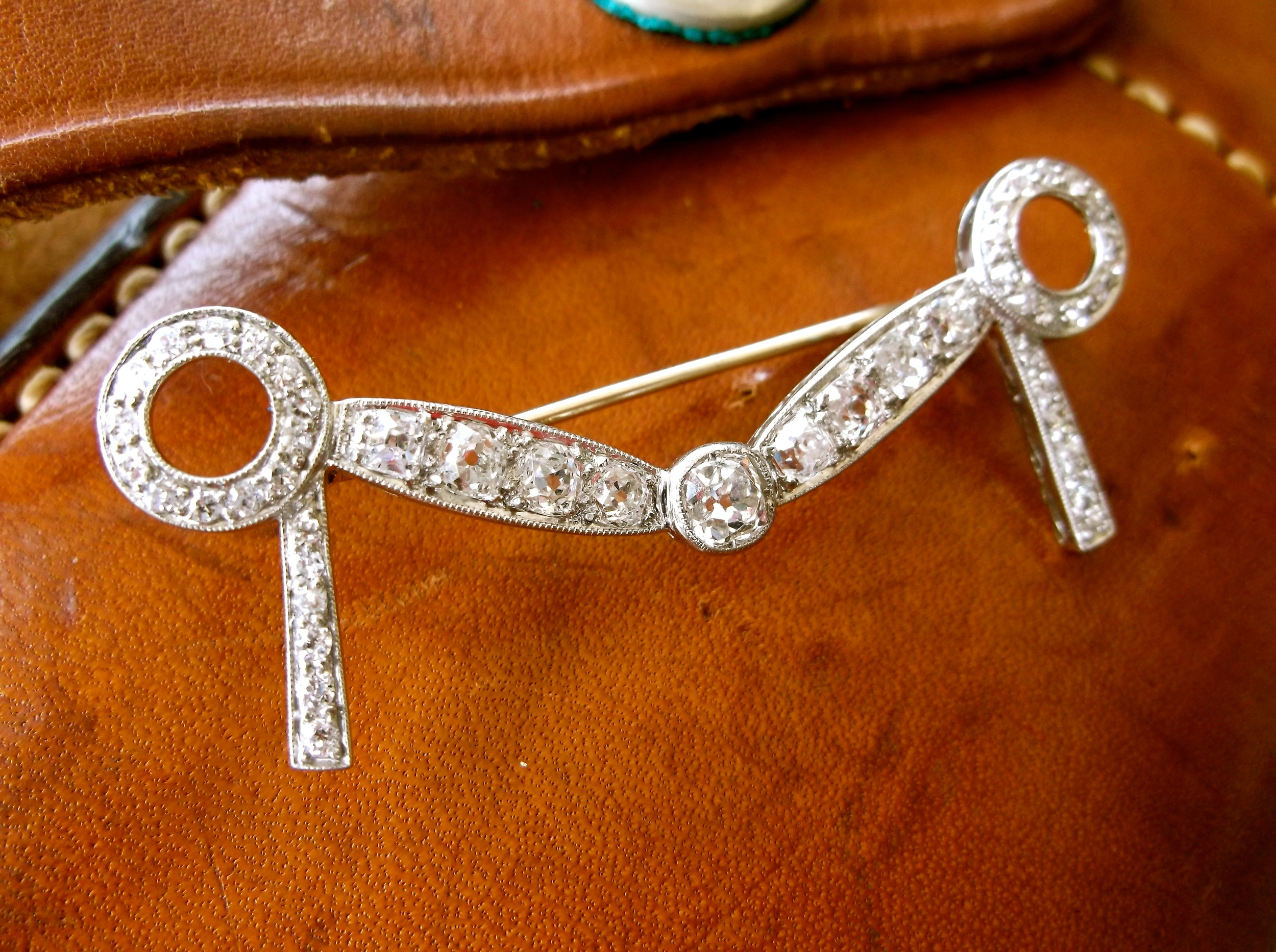 Perfect for the equestrian in your life! Gorgeous Art Deco Old Mine cut diamond bit pin with 1.50 carats total weight in diamonds.