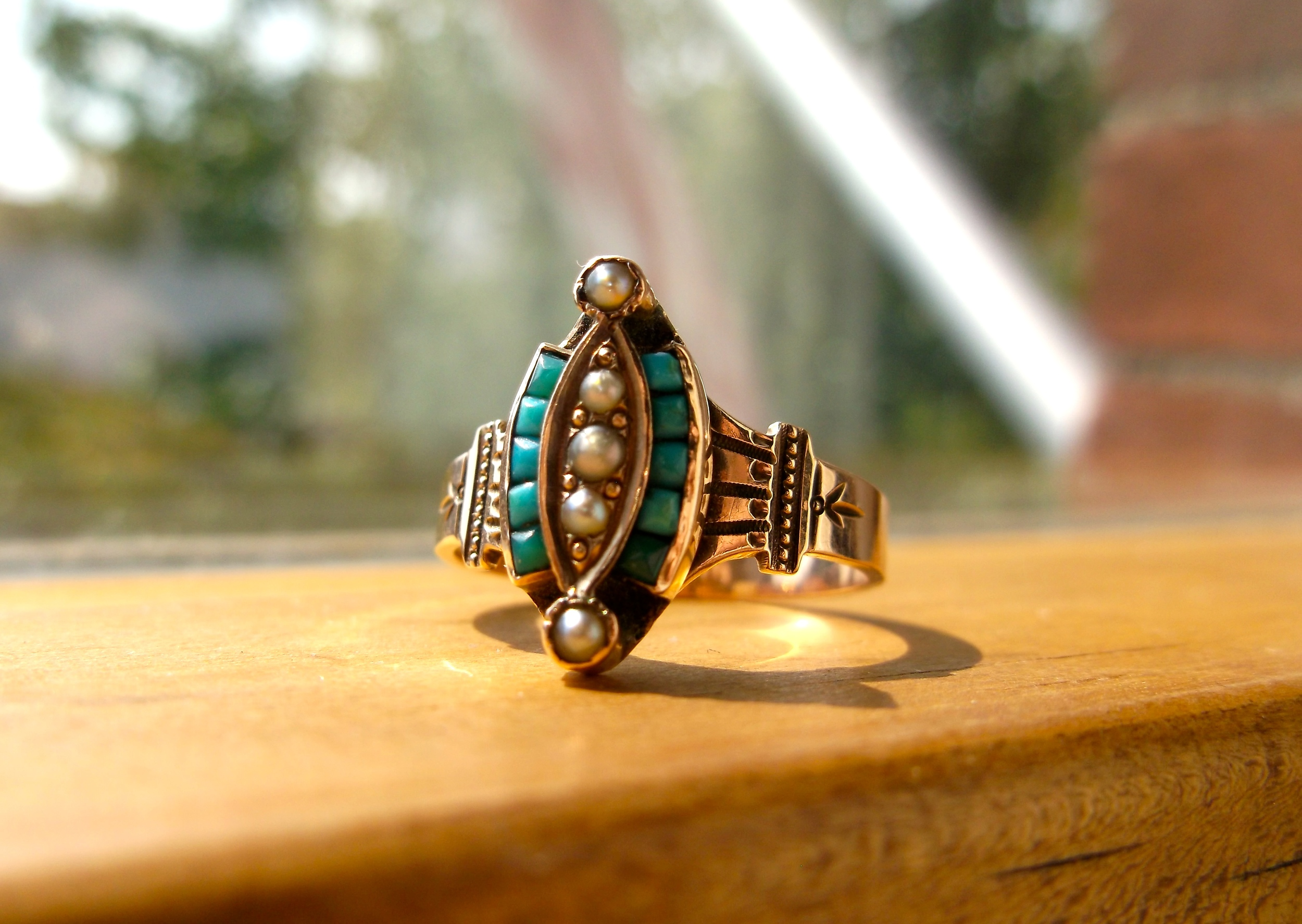 SOLD - Lovely Victorian Era turquoise and seed pearl ring set in yellow gold with beautiful hand engraved detail.
