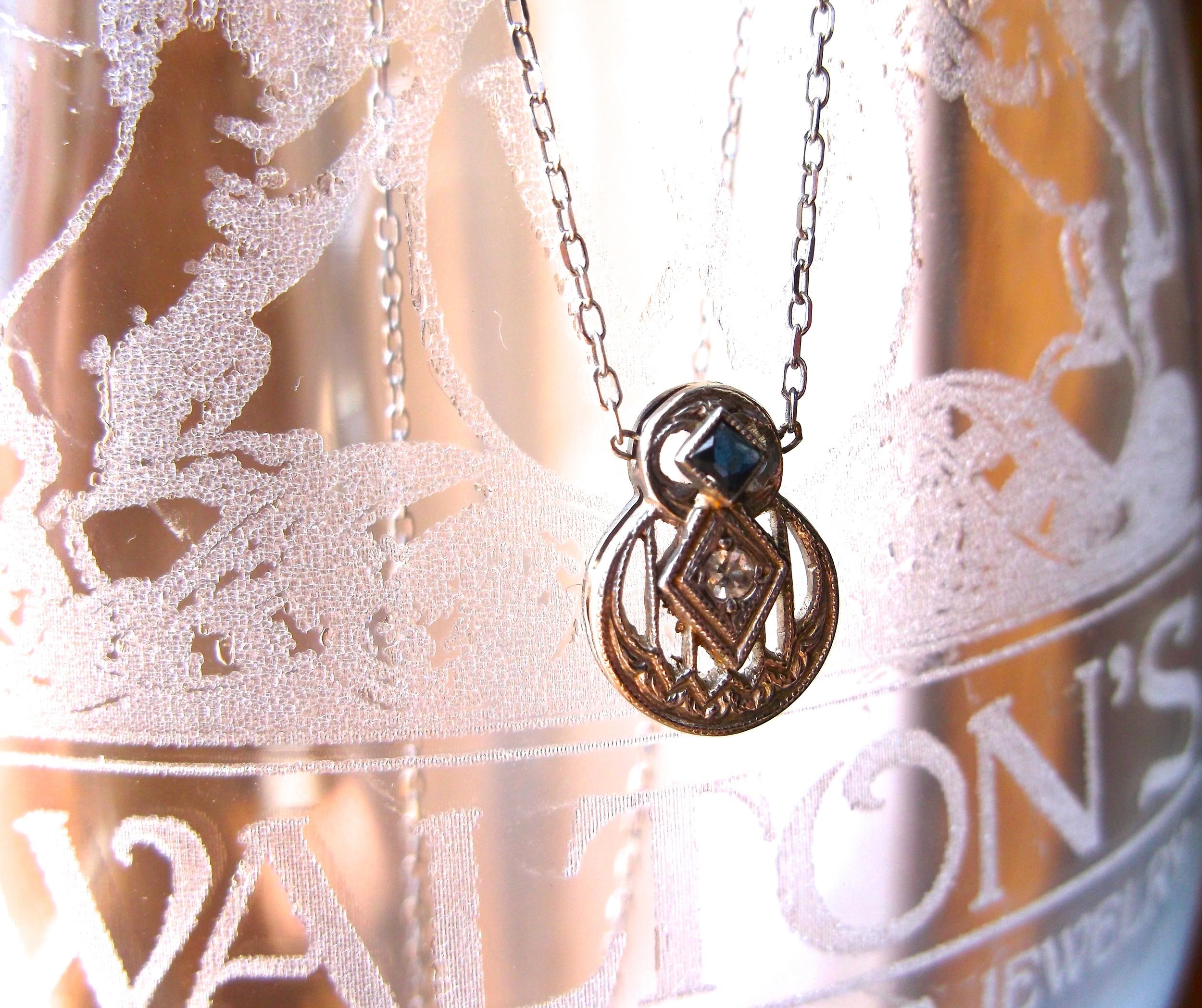 For September: Art Deco diamond, sapphire and white gold pendant.