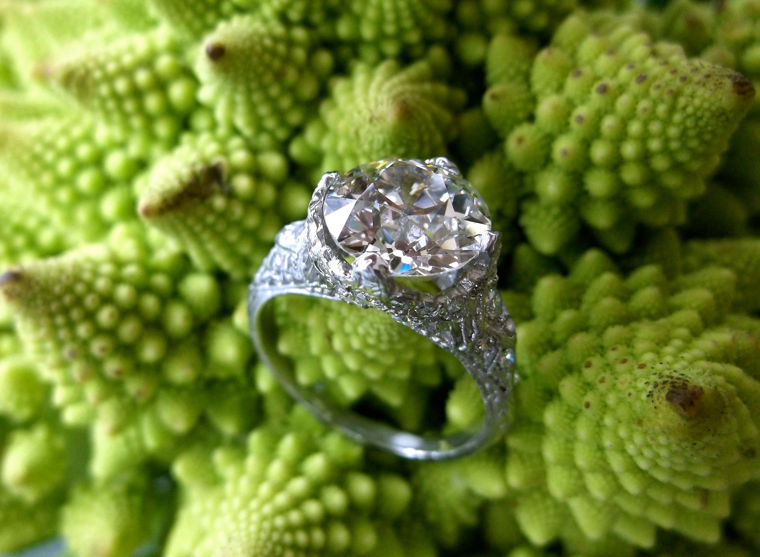 SOLD - Breathtaking 3.09 carat Old European cut diamond set in an Art Deco style platinum and diamond mounting.