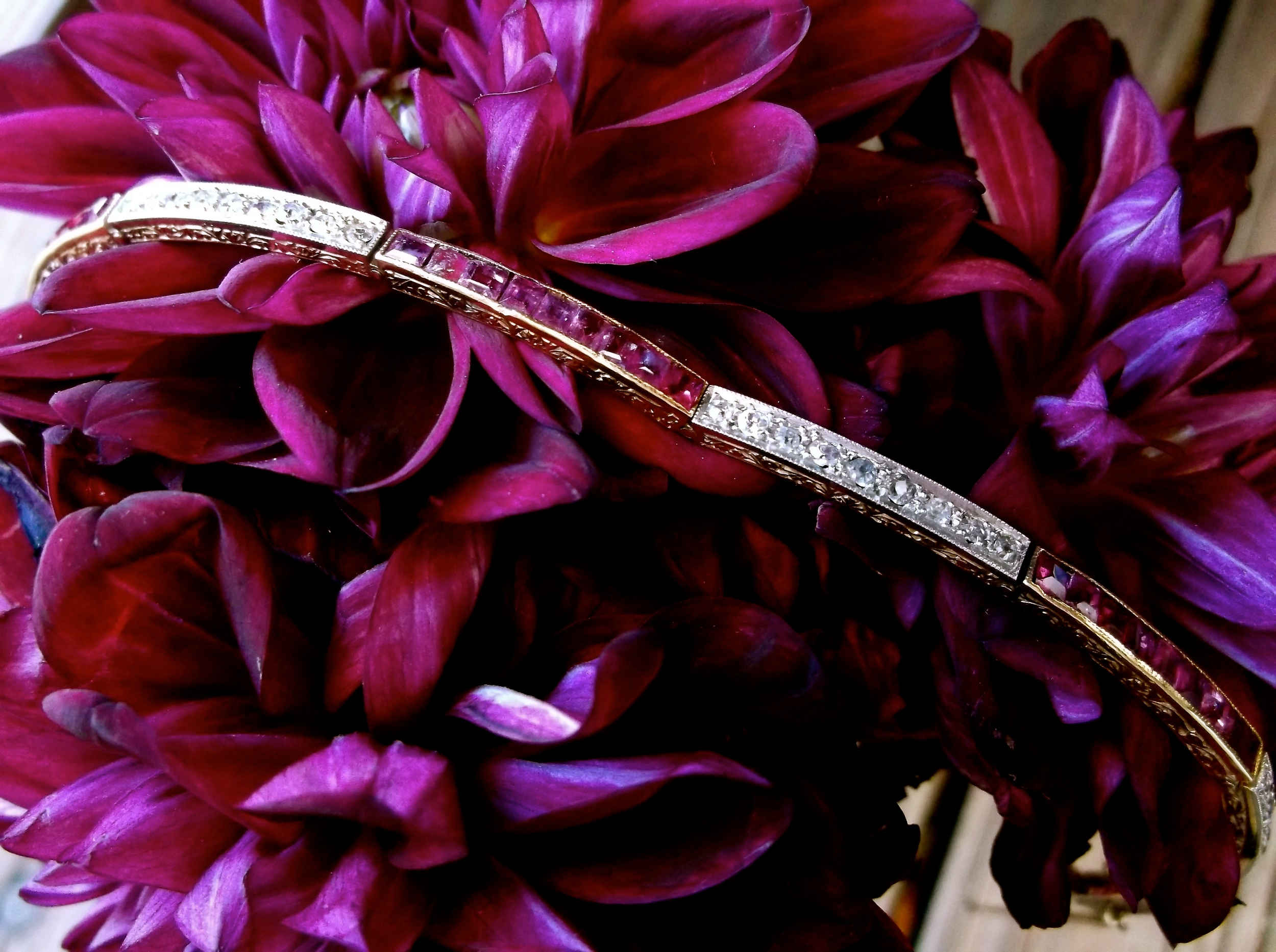 SOLD - Stunning Edwardian Era, platinum topped gold, ruby and diamond bracelet with beautiful hand engraved detail along the sides.