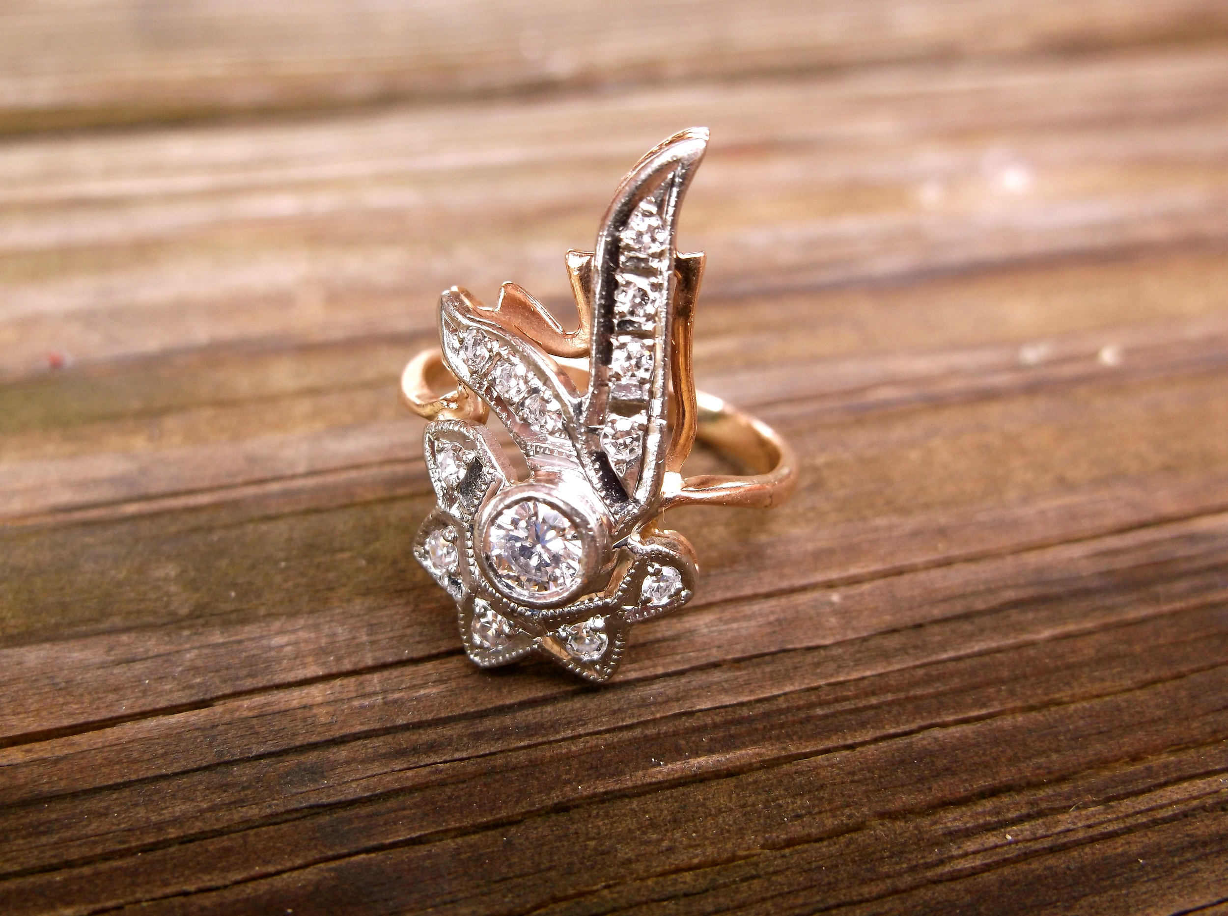 SOLD - 1940's retro rose gold and white gold elongated diamond ring with a 0.15 carat diamond in the center.