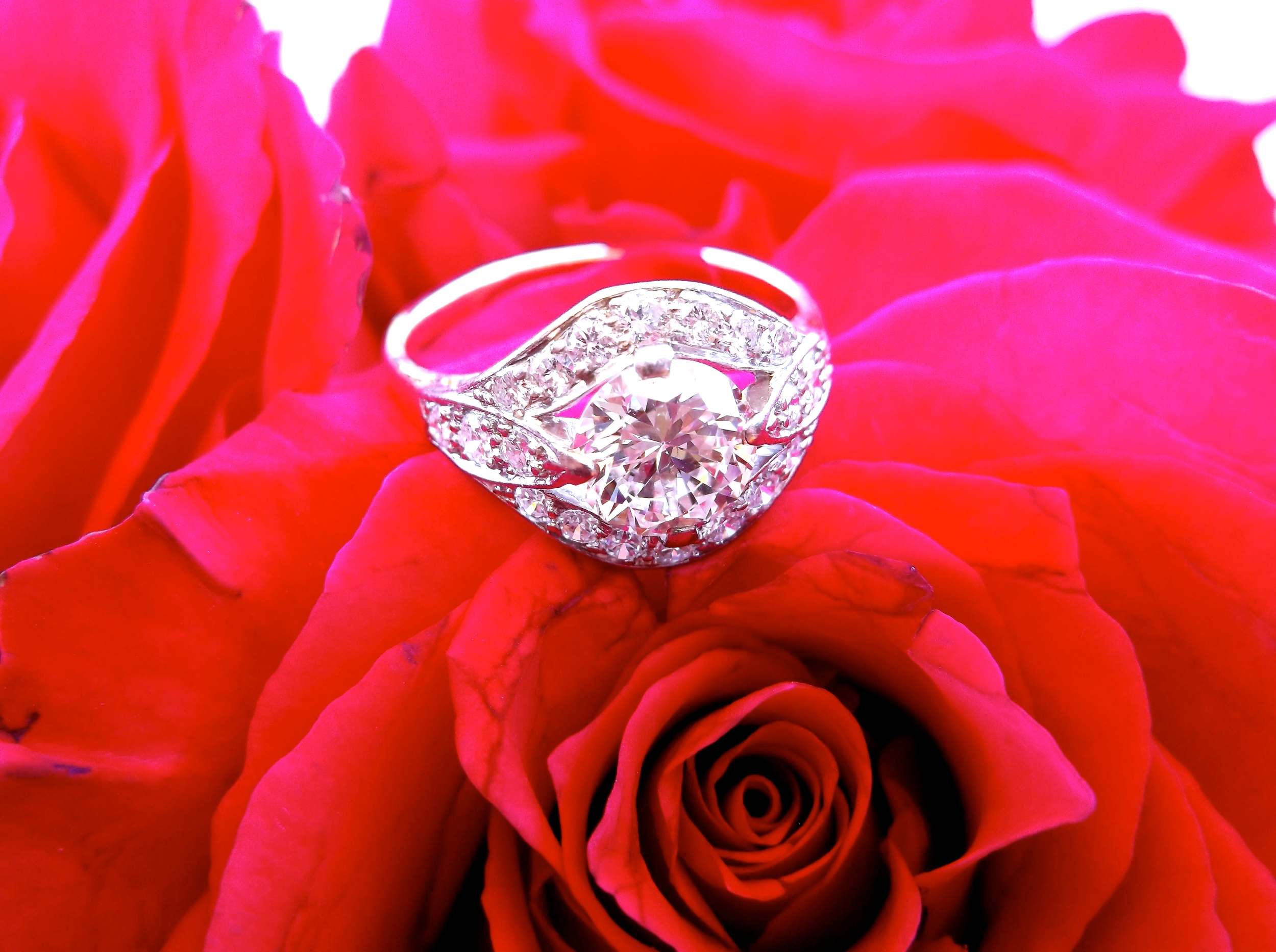 SOLD - Beautiful 1.25 carat diamond set in a yellow gold and white gold diamond detail mounting.