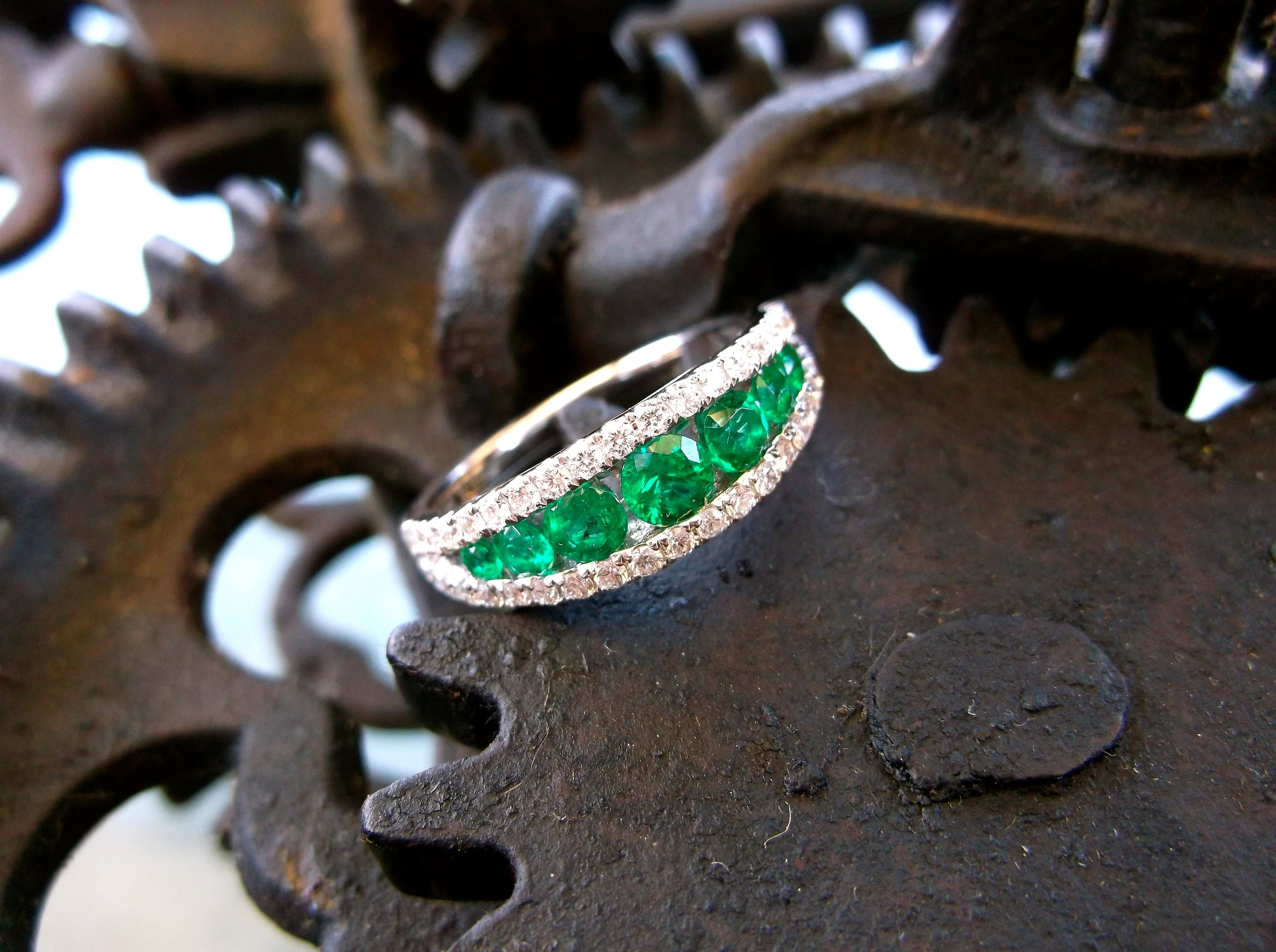 SOLD - Stunning emerald and diamond band set in white gold with 0.61 carats total weight in emeralds and 0.42 carats total weight in diamonds.