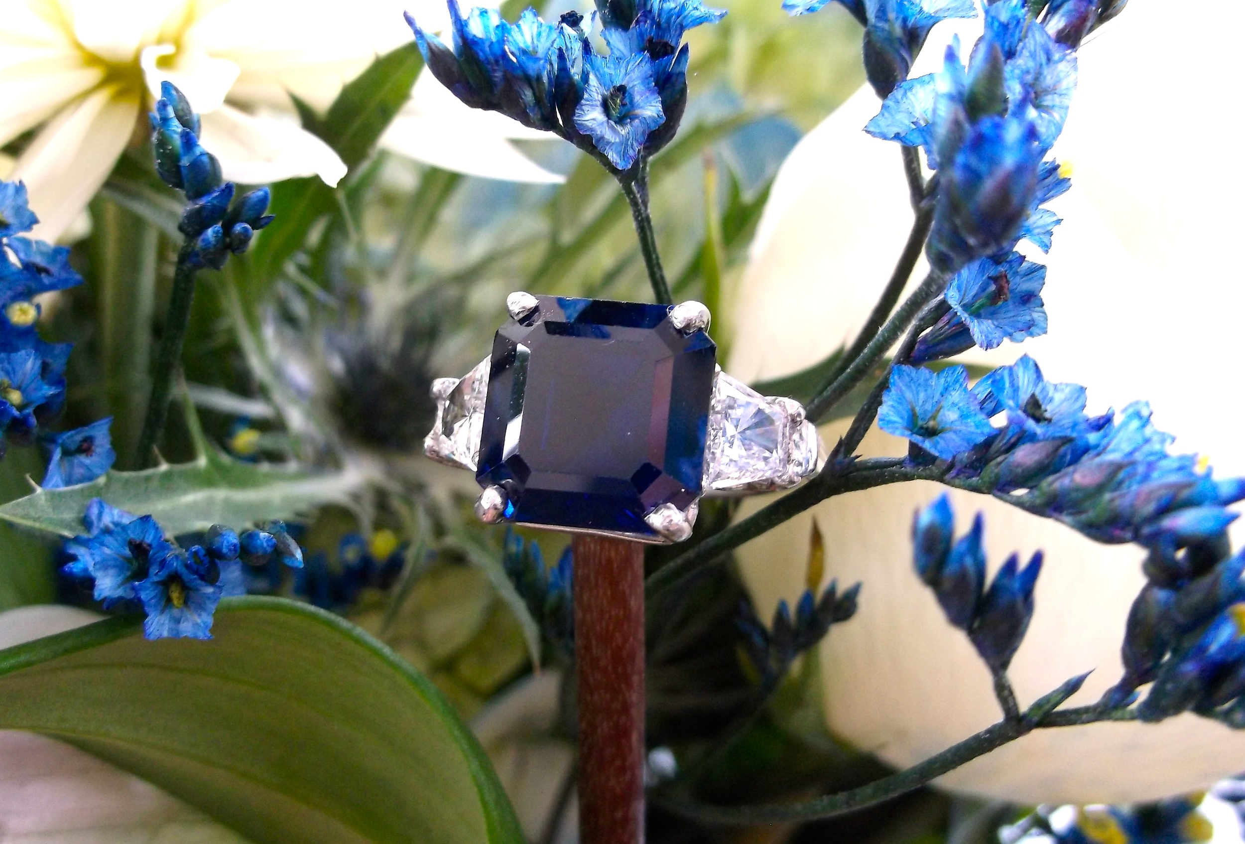 SOLD - Jaw dropping 8.50 carat sapphire set in platinum with 1.40 carats total weight in trapezoid and baguette diamonds on each side.