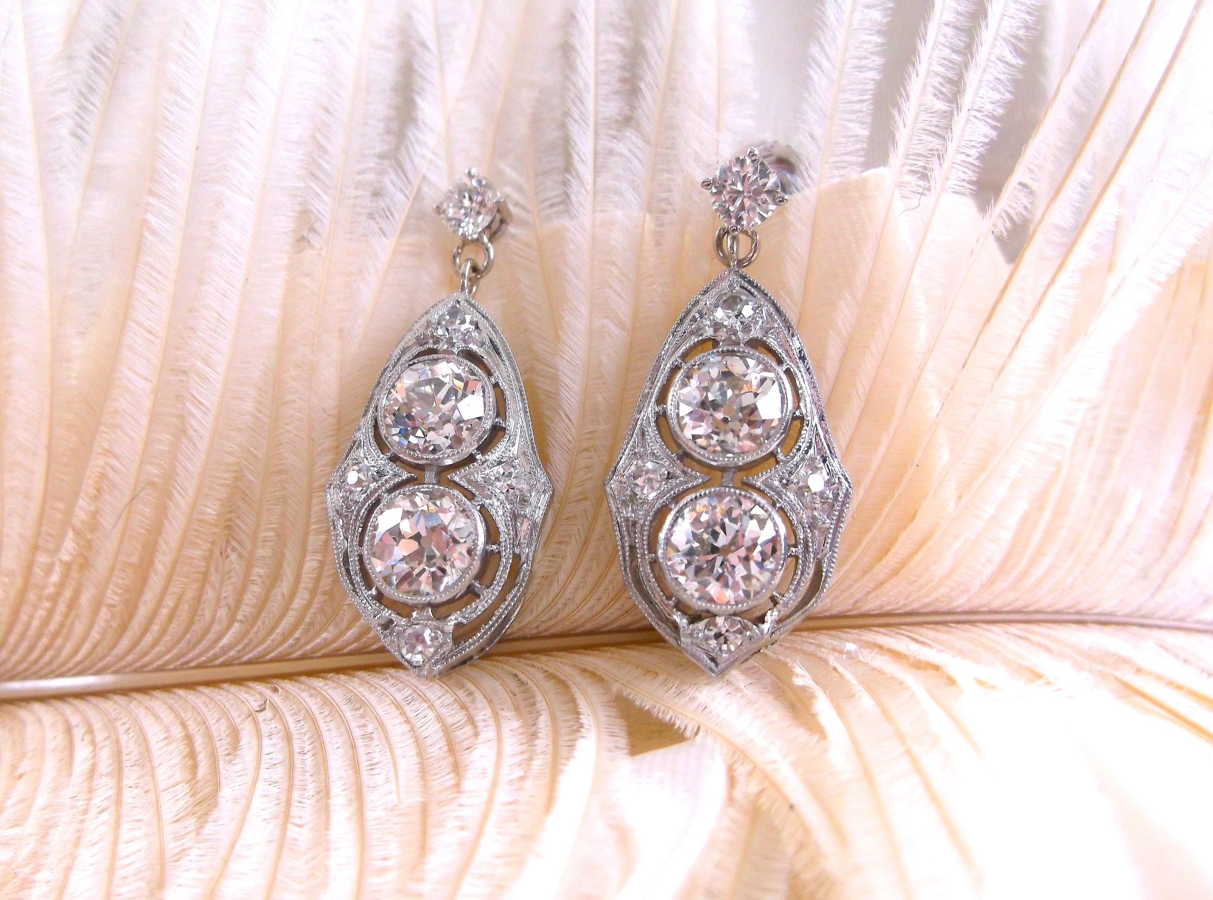 SOLD - Absolutely stunning Art Deco diamond earrings with 3.25 carats total weight in Old European cut diamonds.