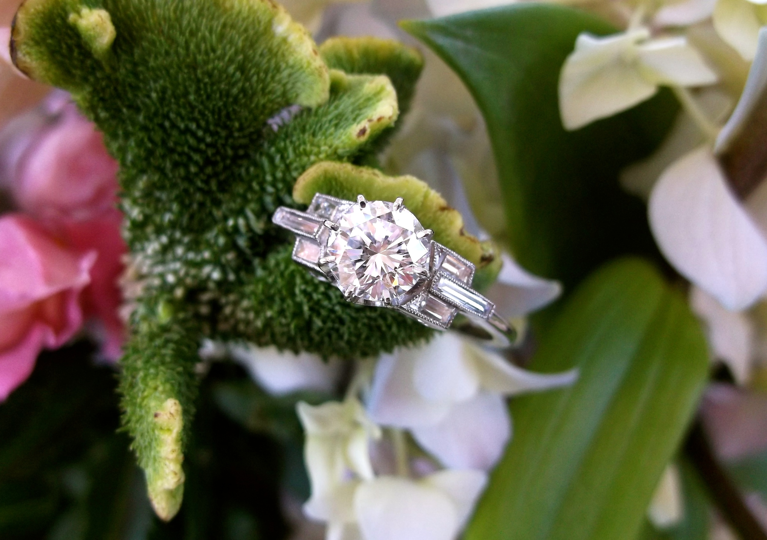 SOLD - Beautifully architectural 1.03 carat diamond ring with baguette diamond detail set in platinum.