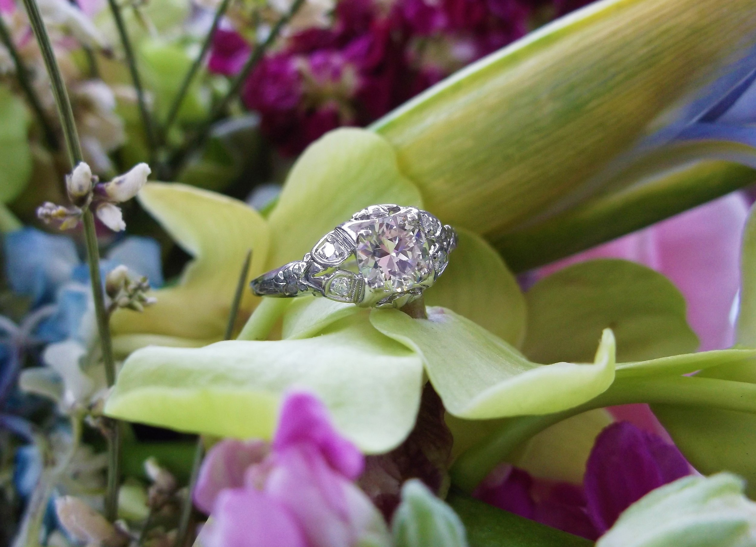 SOLD - Beautiful 1920's 0.68 carat Old European cut diamond set in a lovely platinum and diamond detail mounting.