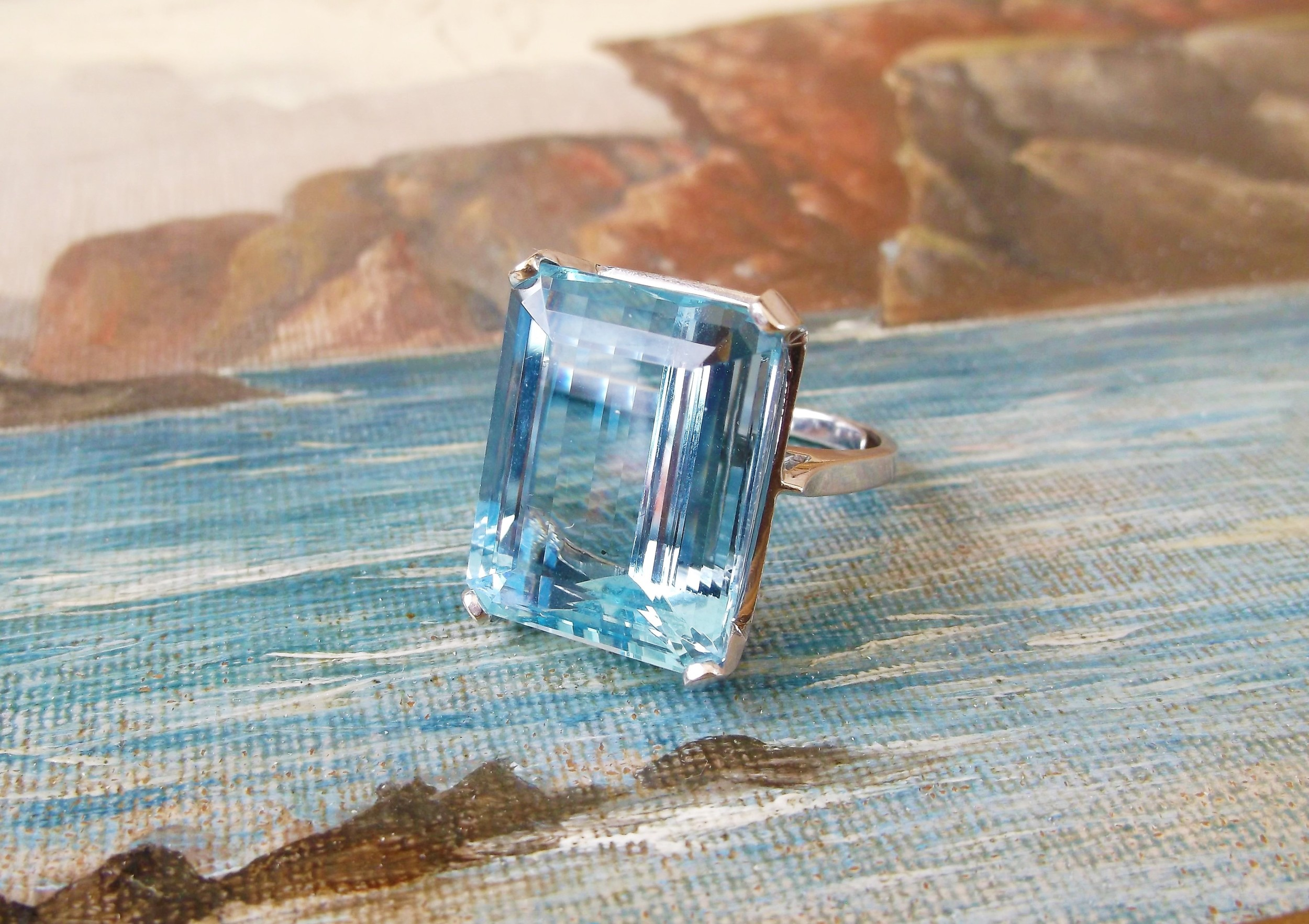 SOLD - Beautiful 24.62 carat aquamarine set in a simple 18K white gold setting.
