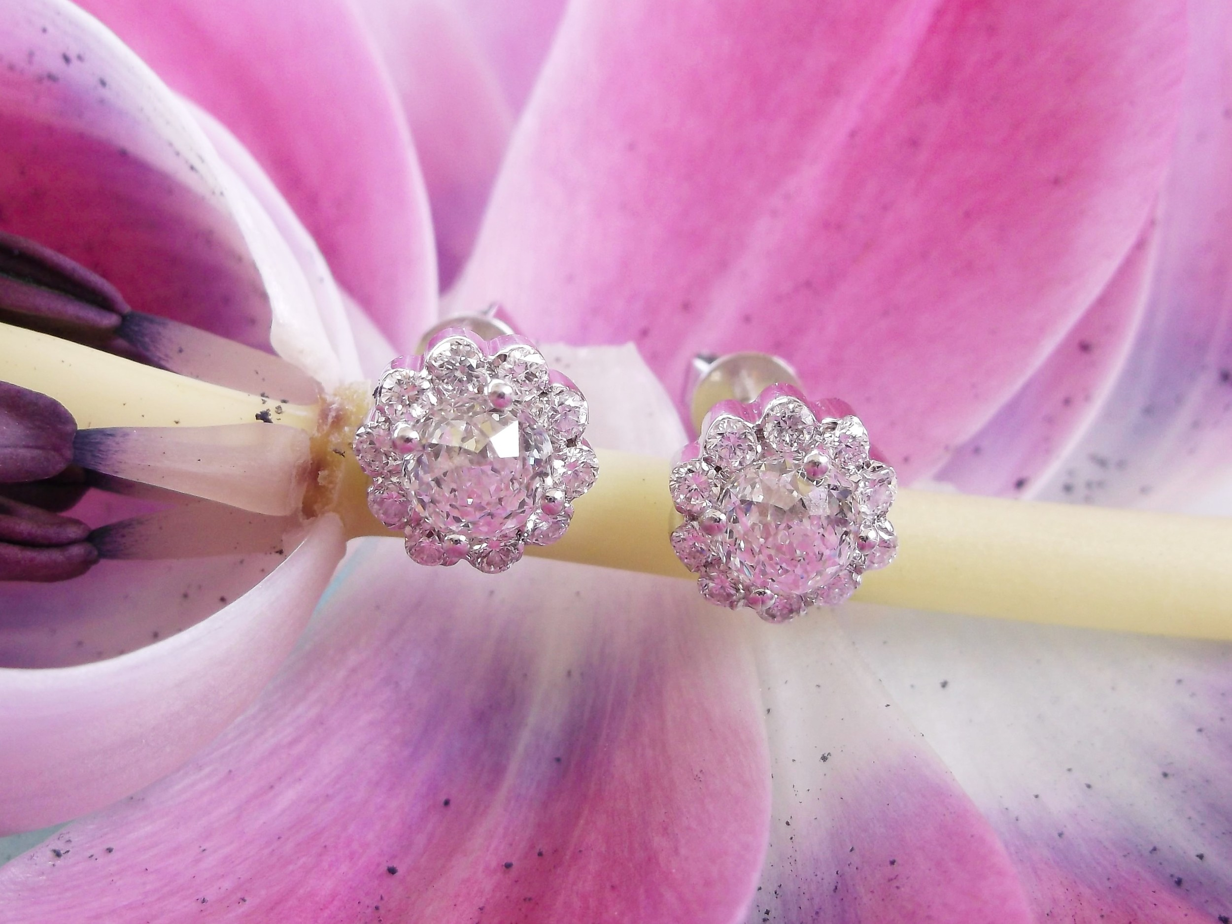 SOLD - Lovely white gold and diamond cluster earrings with a center briolette style diamond surrounded by smaller round diamonds.