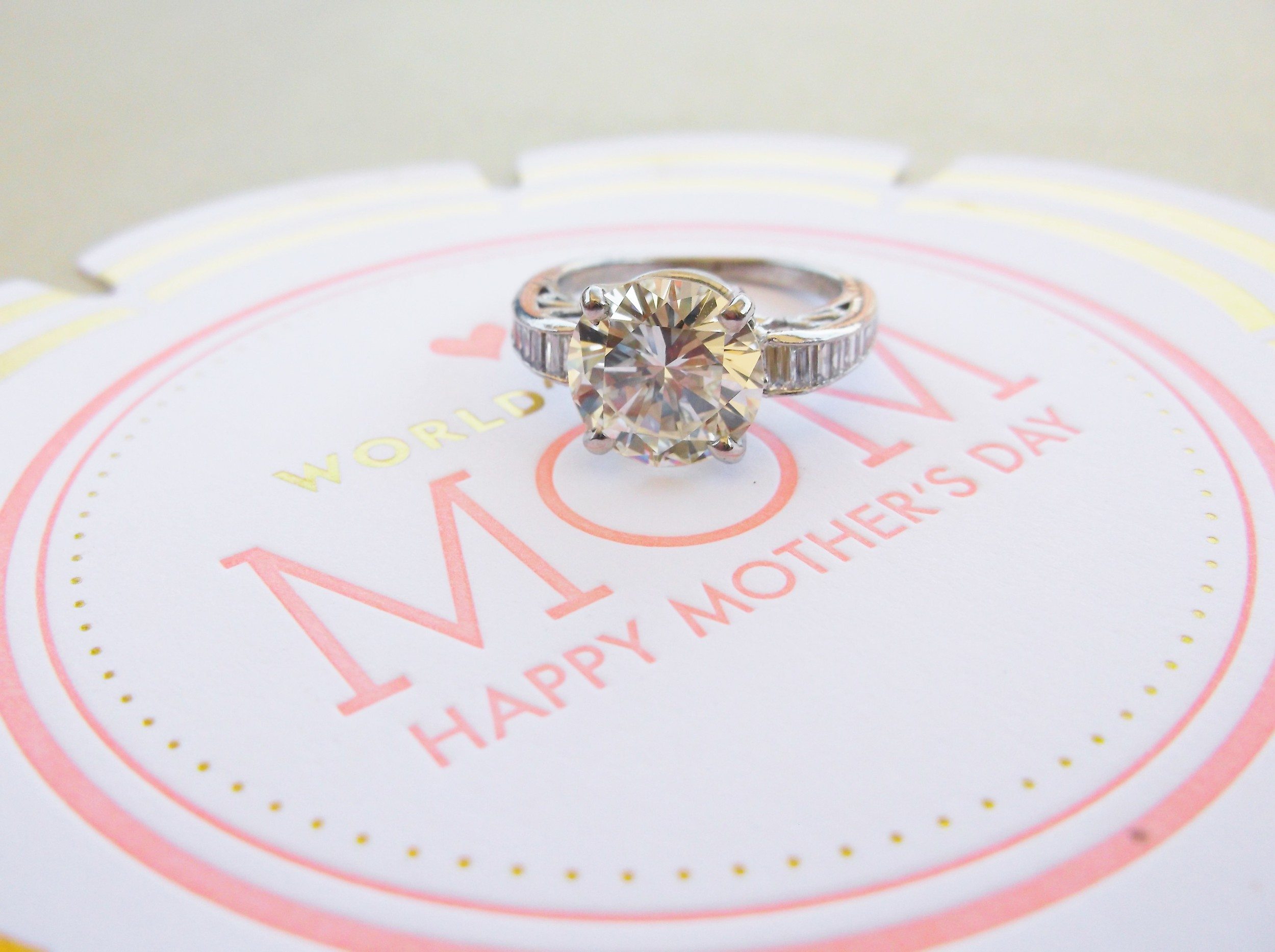 SOLD - Stunning 3.58 carat diamond set in a platinum and baguette diamond detail mounting.