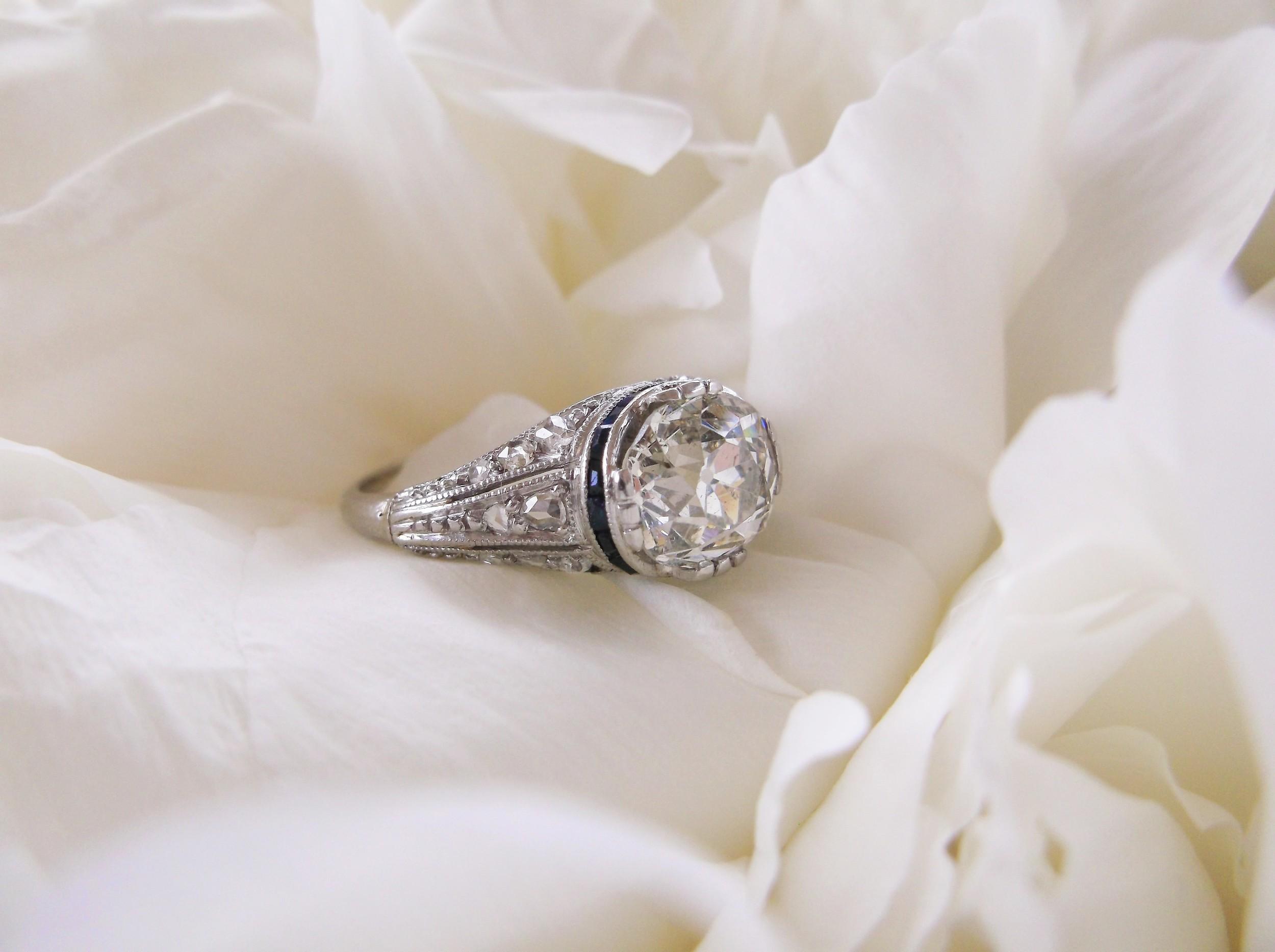 SOLD - Gorgeous 1.85 carat Old Mine cut diamond set in a beautiful Art Deco diamond, sapphire and platinum mounting.