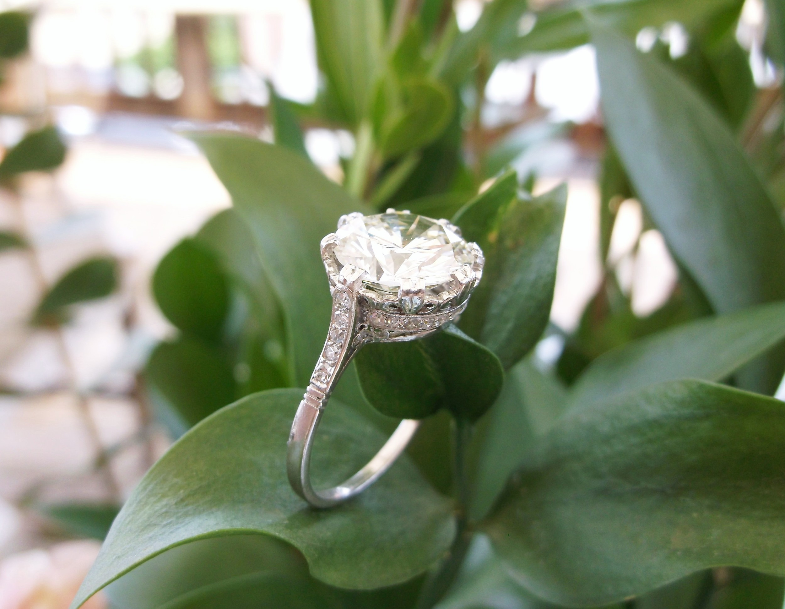 SOLD - Jaw dropping 3.58 carat round diamond set in a stunning Art Deco diamond and platinum mounting.