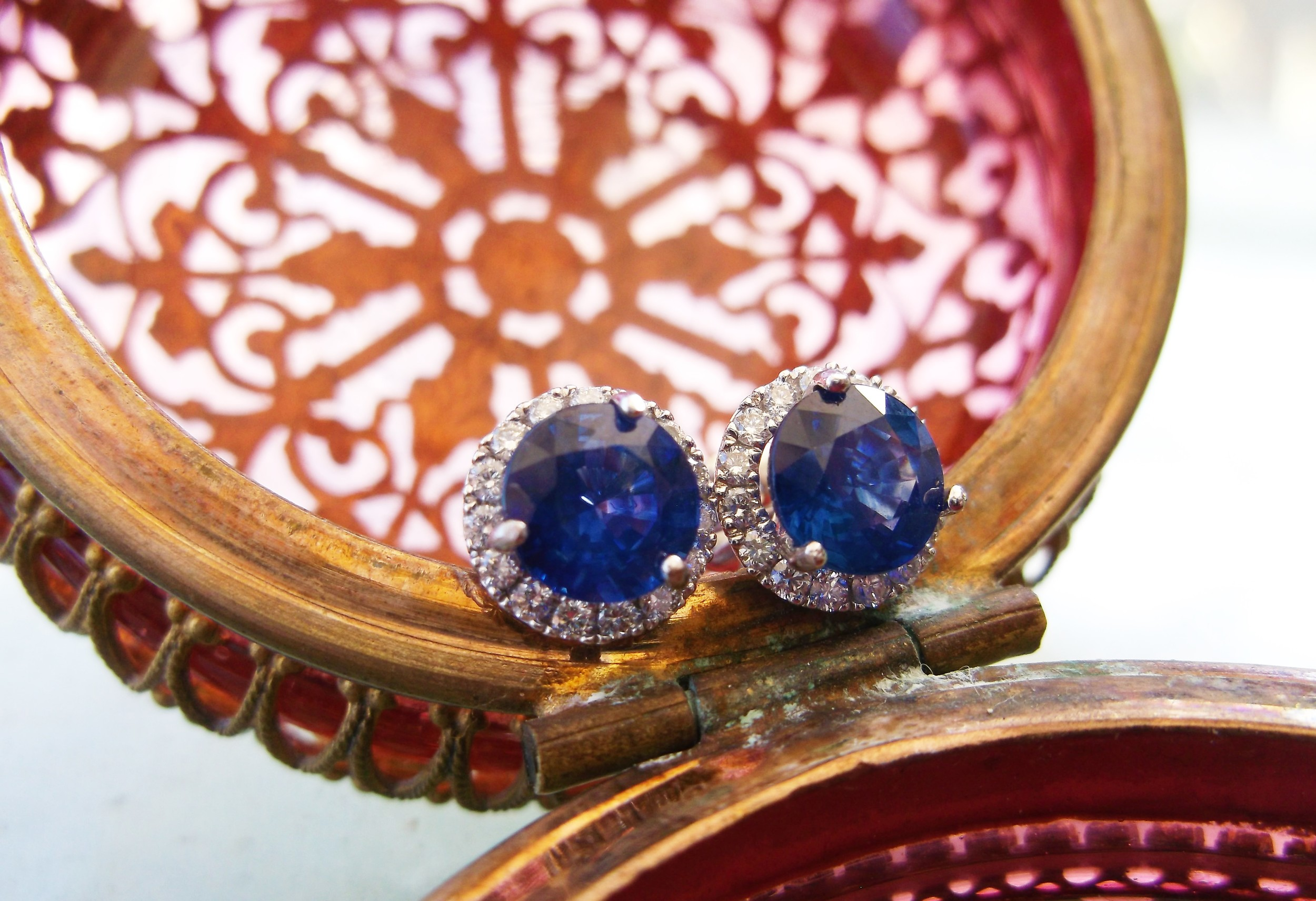 SOLD - Beautiful diamond and sapphire stud earrings with a 1.00 carat sapphire set in each.