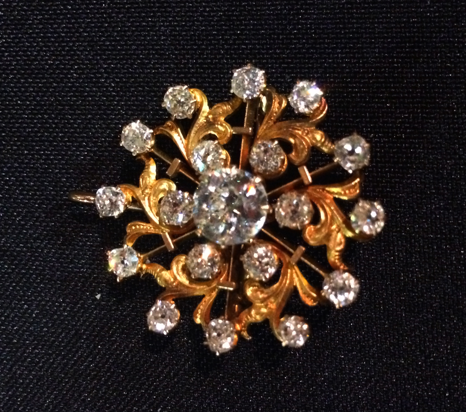 Victorian Era Old Mine cut diamond and gold starburst broach.