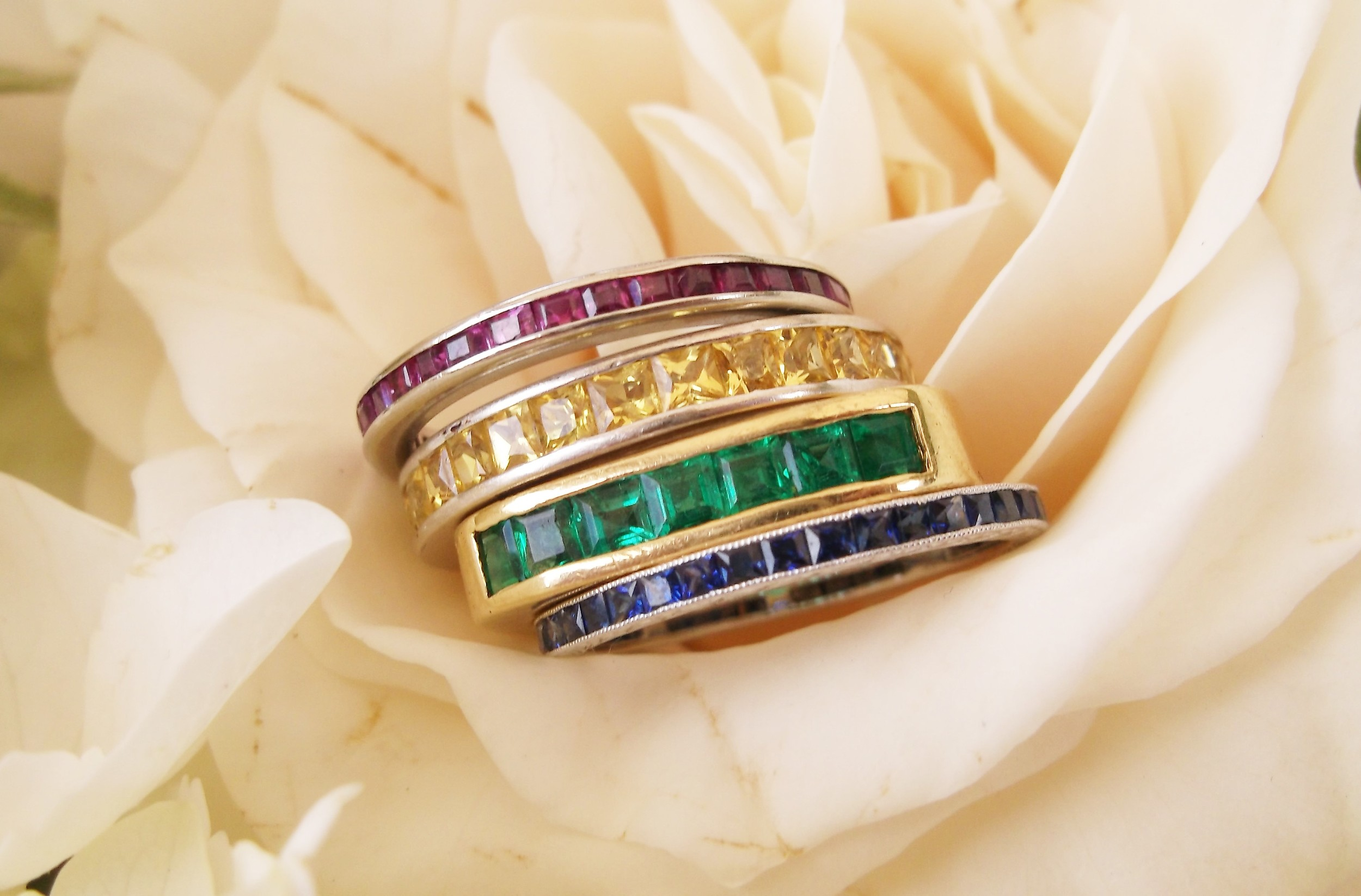 Lovely ruby and platinum, yellow sapphire and white gold, emerald and yellow gold and sapphire and platinum bands.