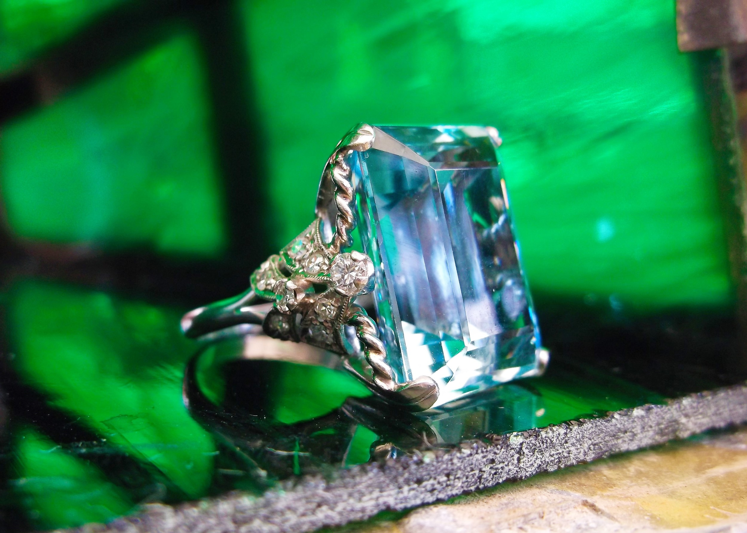 SOLD - Breathtaking 1920's 23 carat aquamarine set in a beautiful diamond and platinum mounting.