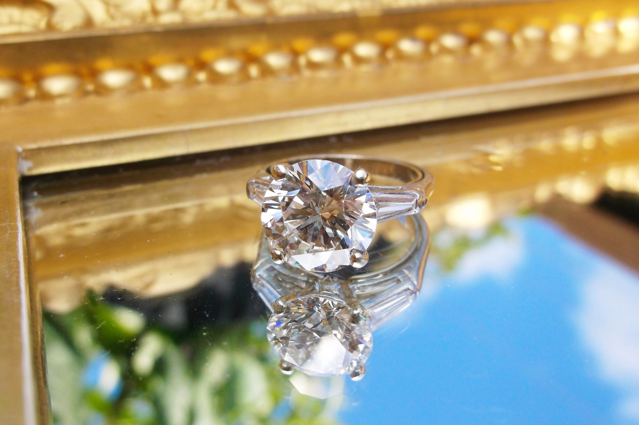 SOLD - So gorgeous, we're seeing double! 4.04 carat round brilliant cut diamond set in a classic baguette cut diamond and platinum setting.