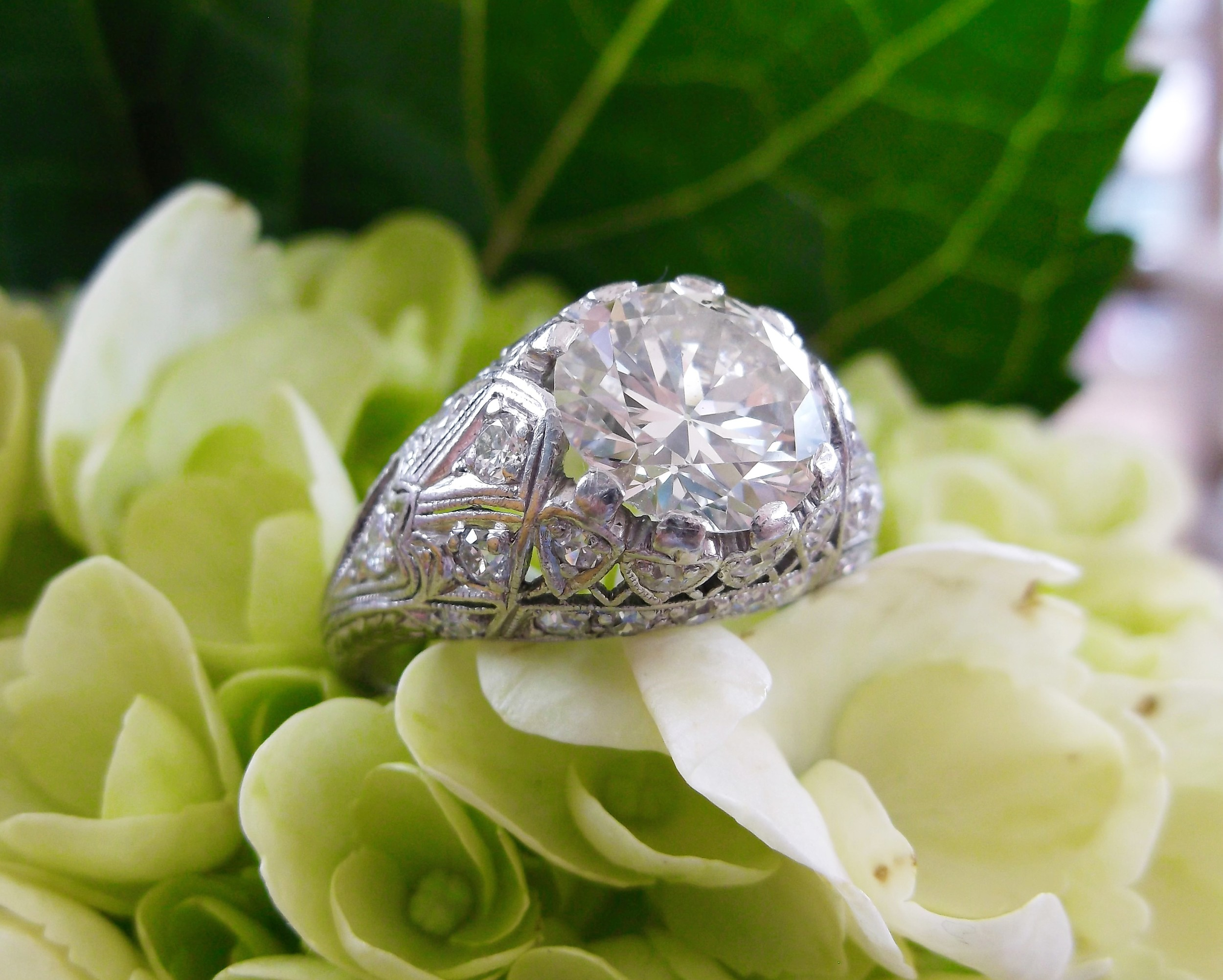 Stunning 1920's 2.40 carat Old European cut diamond in a beautiful diamond and platinum mounting.
