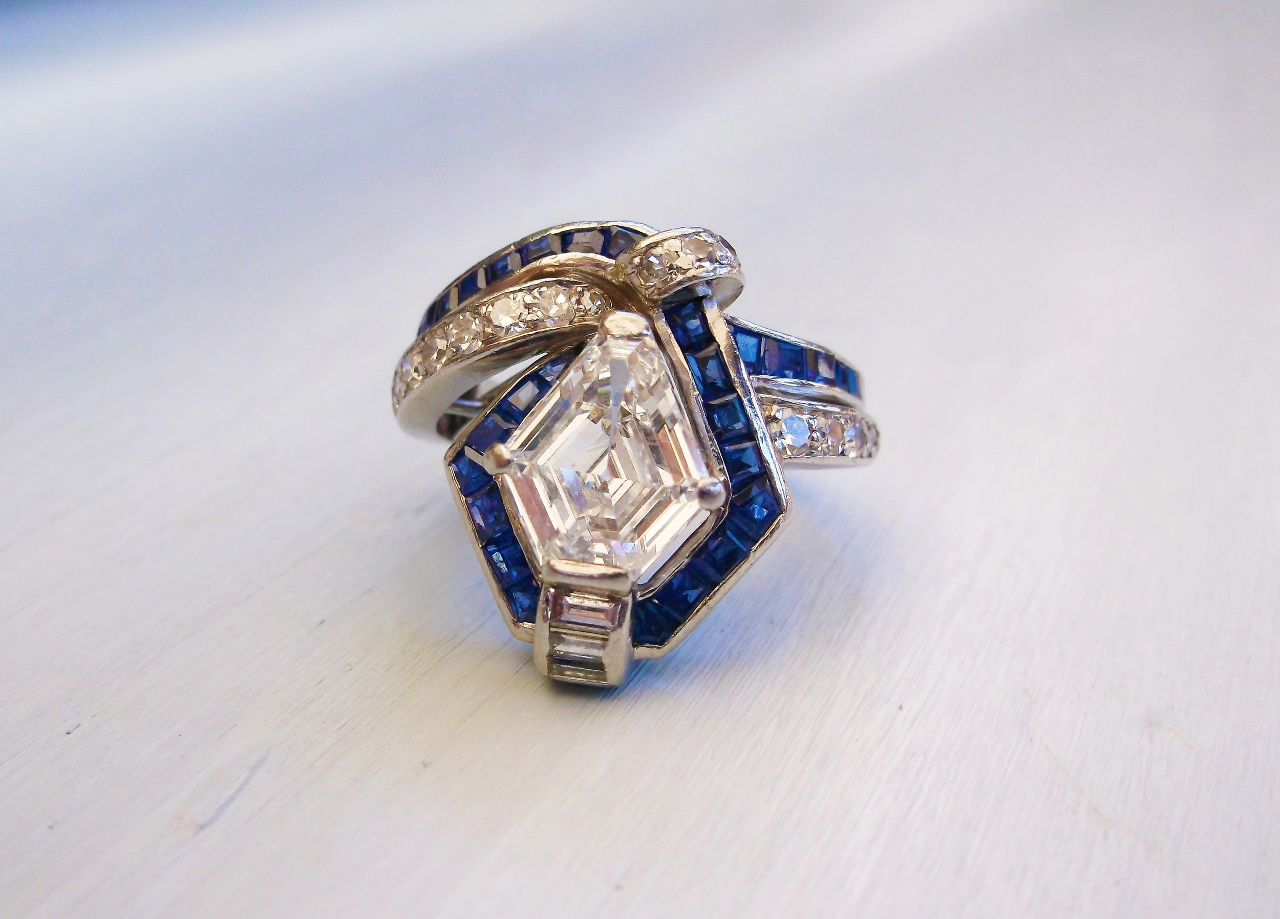 SOLD - Exquisite 1920's diamond, sapphire and platinum ring that features a gorgeous 2.07 carat kite shaped diamond!
