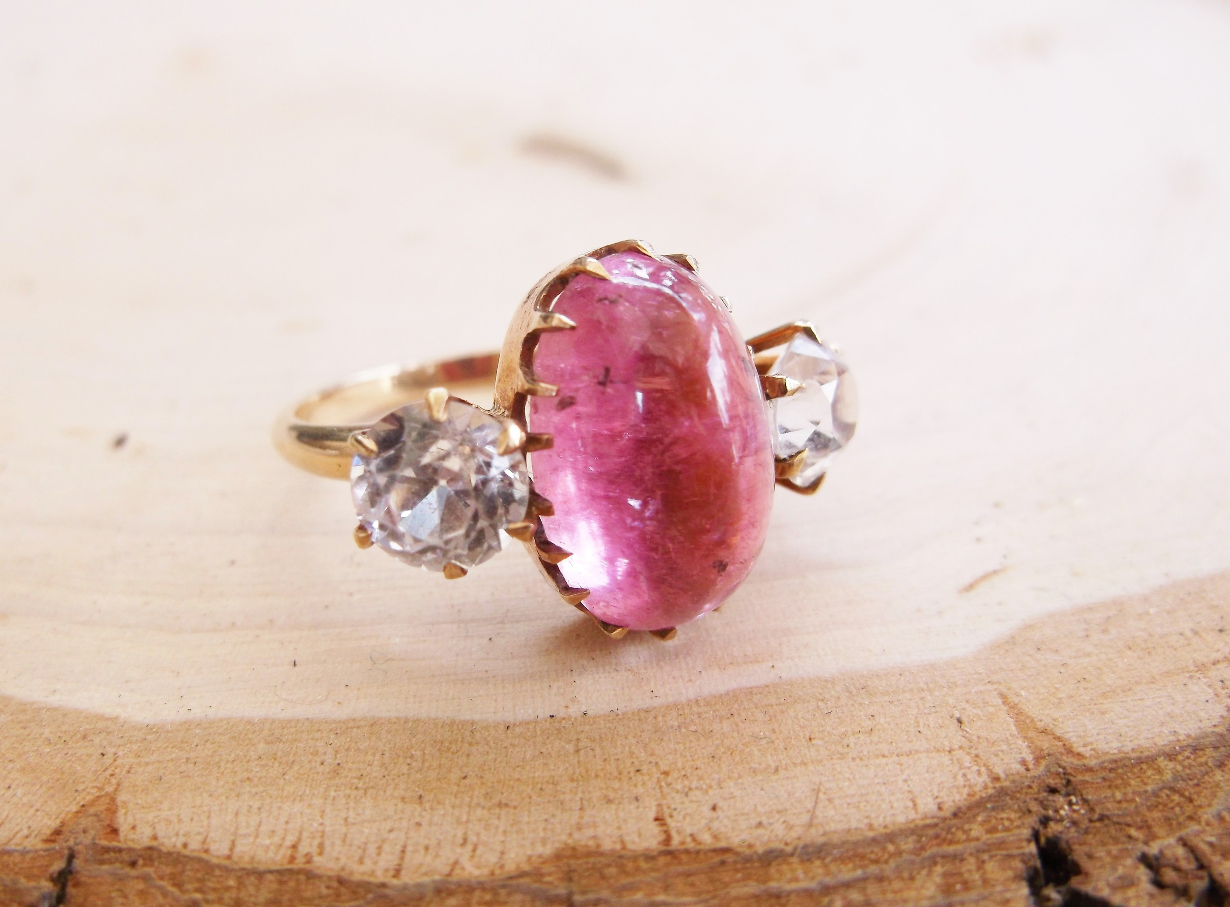 SOLD - Wonderfully unique 6.28 carat cabochon cut pink tourmaline ring with a 1.15 carat white sapphire on each side.