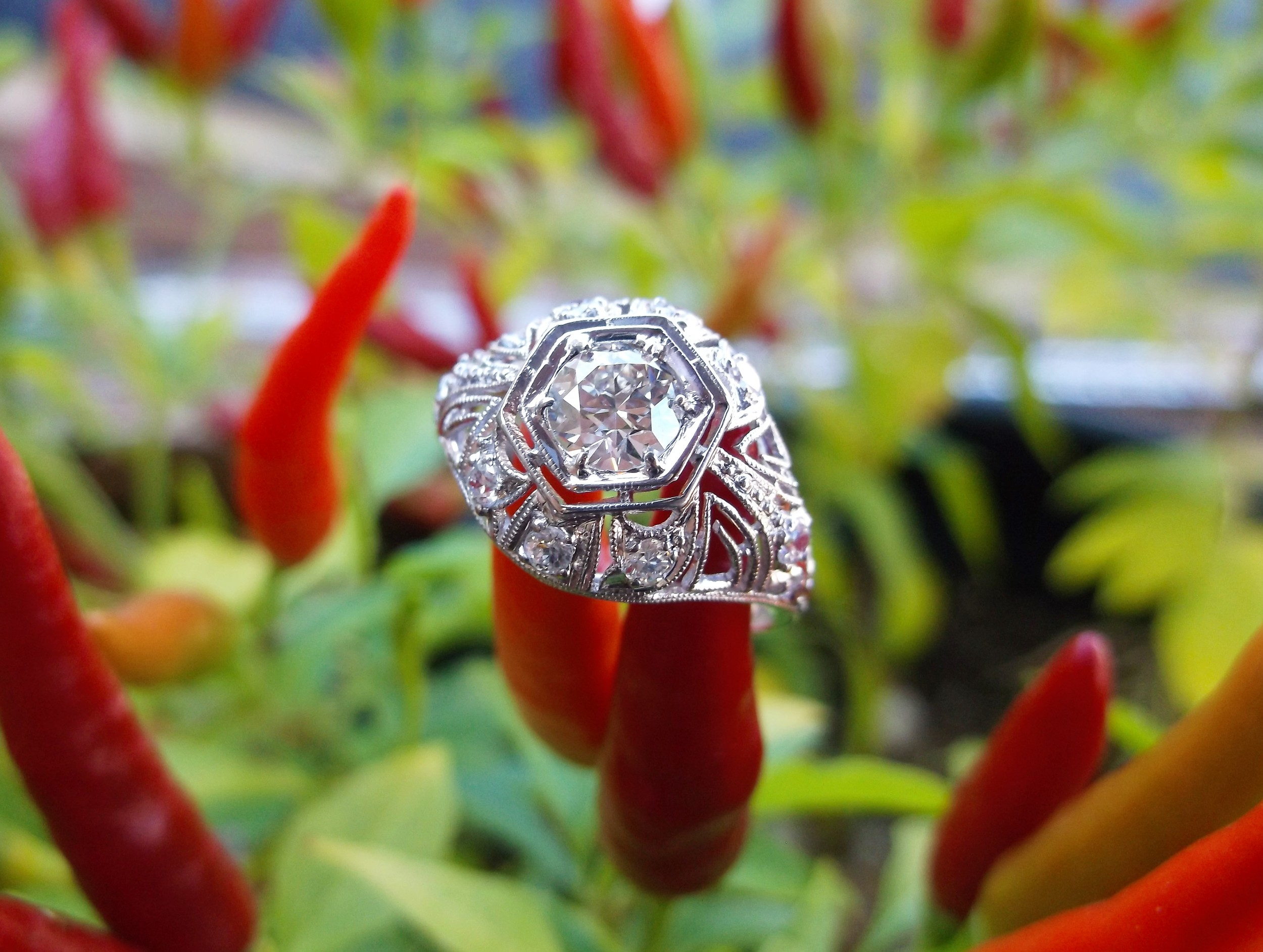 SOLD - Beautiful 1920's 0.47 carat Old European cut diamond set in a platinum and diamond detail mounting.