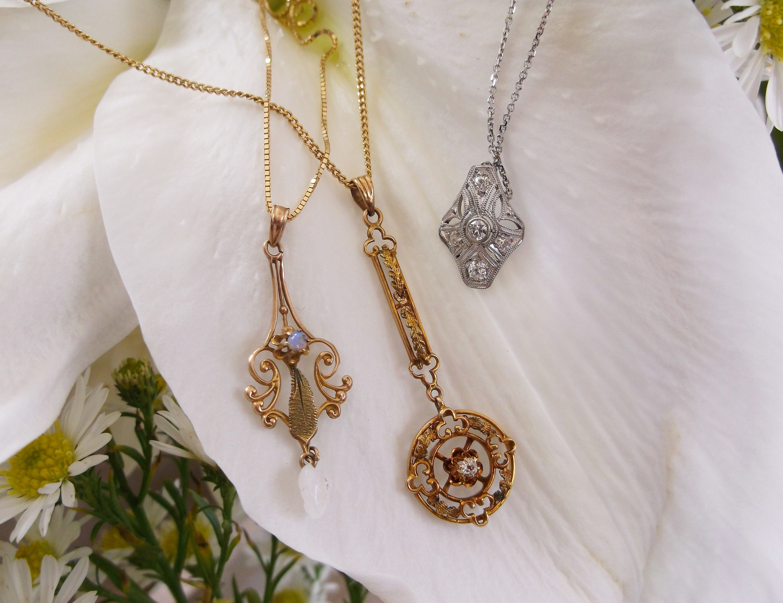 Lovely collection of antique pendants! Left: SOLD - Victorian era 10K yellow gold, opal and pearl pendant. Middle: SOLD - Victorian era 10K yellow gold and diamond pendant. Right: SOLD -  Art Deco era 0.20 carat total weight diamond and platinum pendant.