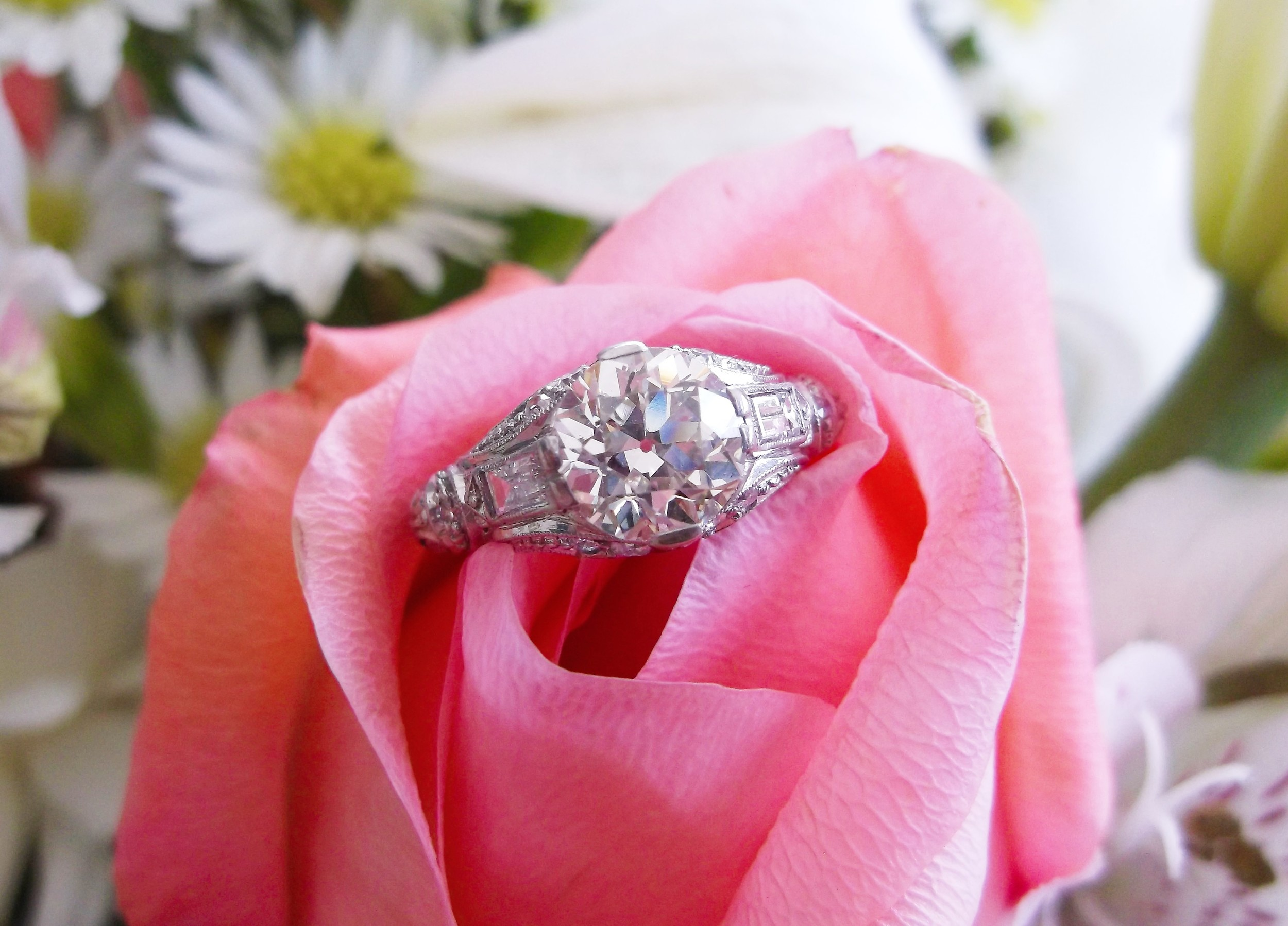 SOLD - Gorgeous 1.54 carat Old European cut diamond set in a beautiful platinum and diamond detail mounting.