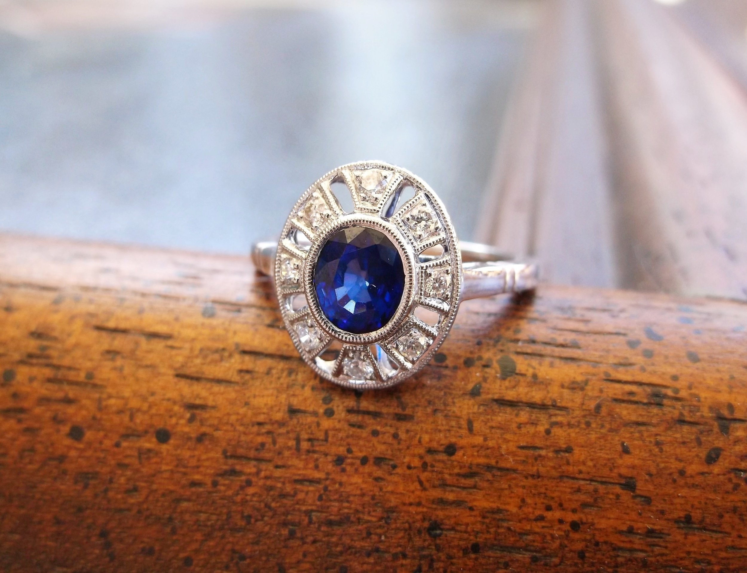 SOLD - Gorgeous 1.18 carat oval cut sapphire in a beautiful diamond and white gold mounting.