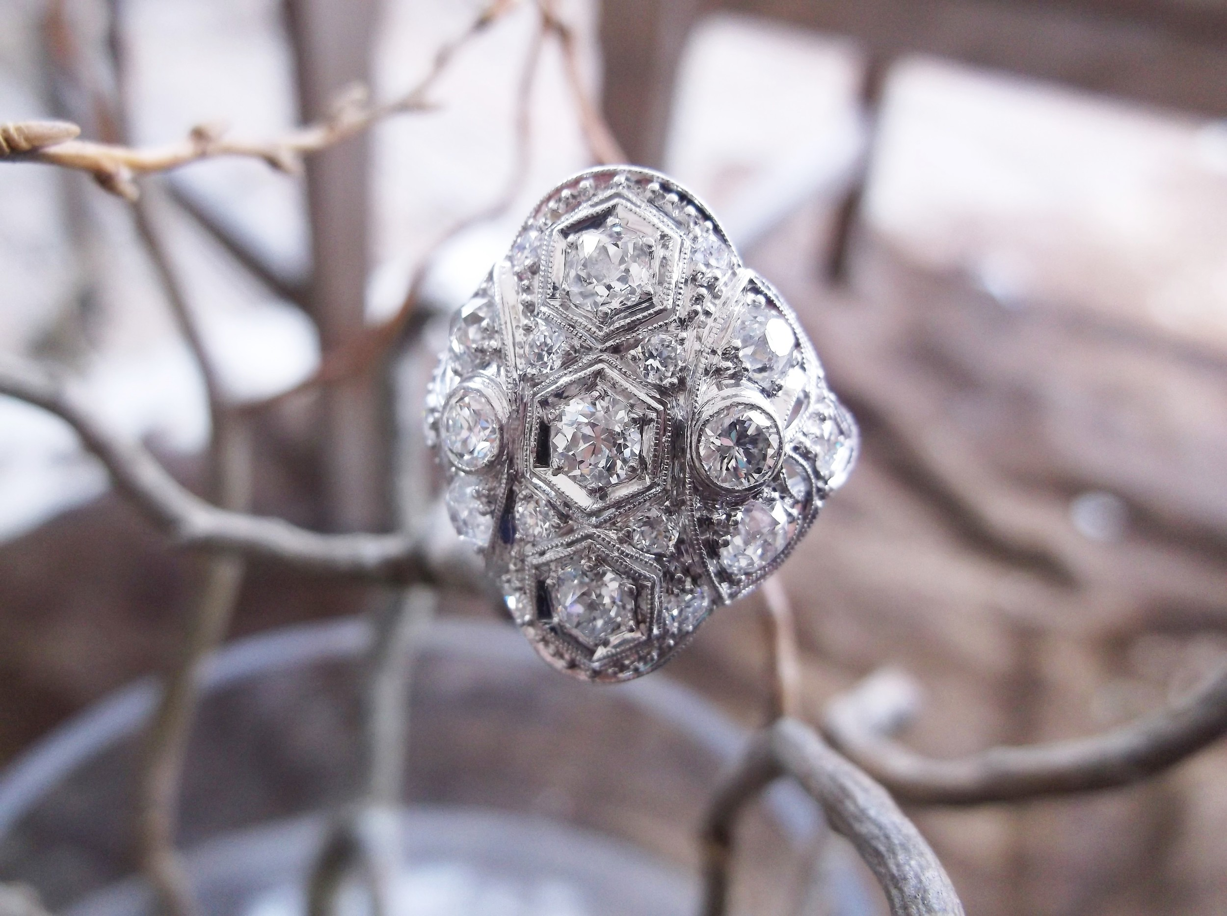SOLD - The ultimate statement piece! 1.65 carats total weight in Old Mine cut diamonds set in platinum, circa 1920's.