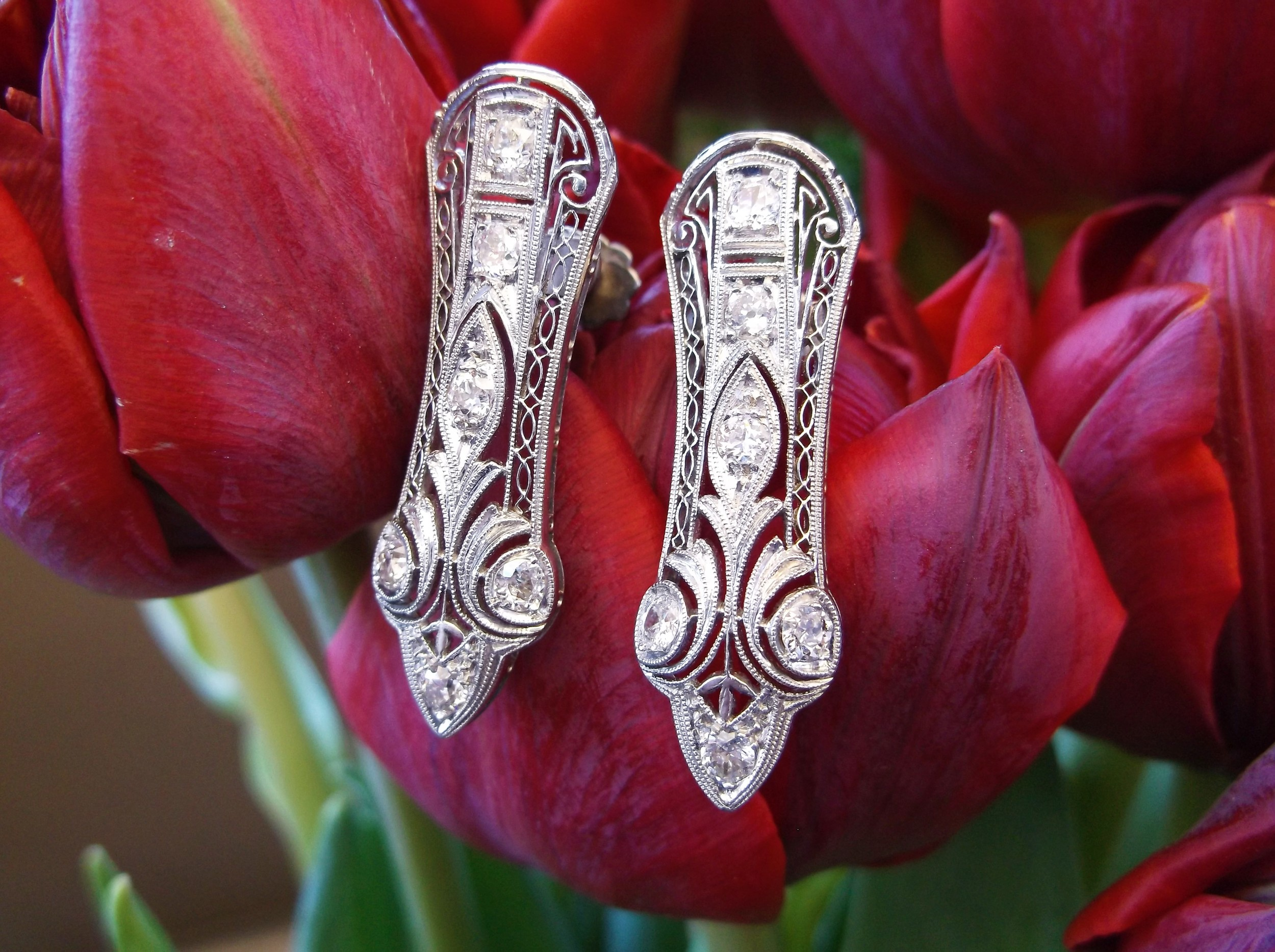 SOLD - Mesmerizing Art Deco Old Mine cut diamond and platinum filigree earrings.