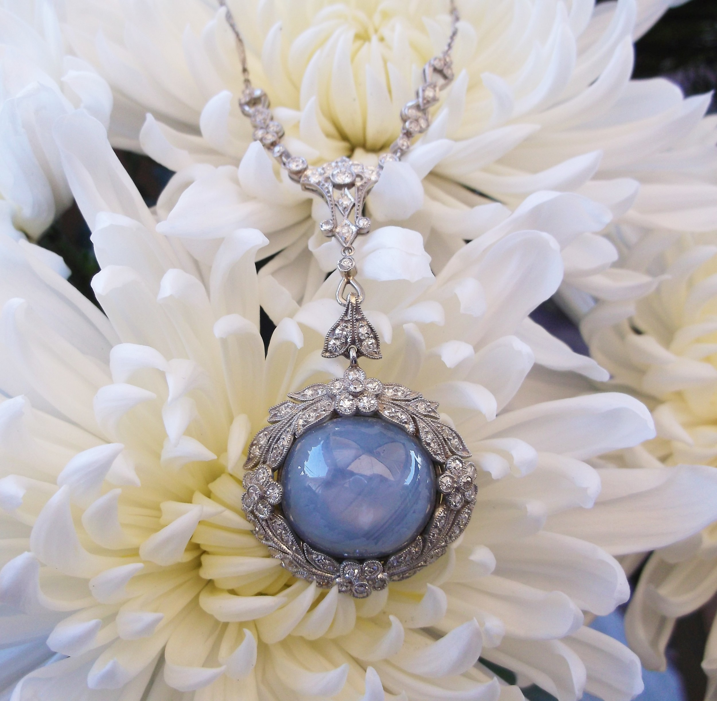 SOLD - Incredible Art Deco star sapphire and diamond pendant.  The star sapphire is approximately 27.84 carats with approximately 1.50 carats total weight in diamonds.