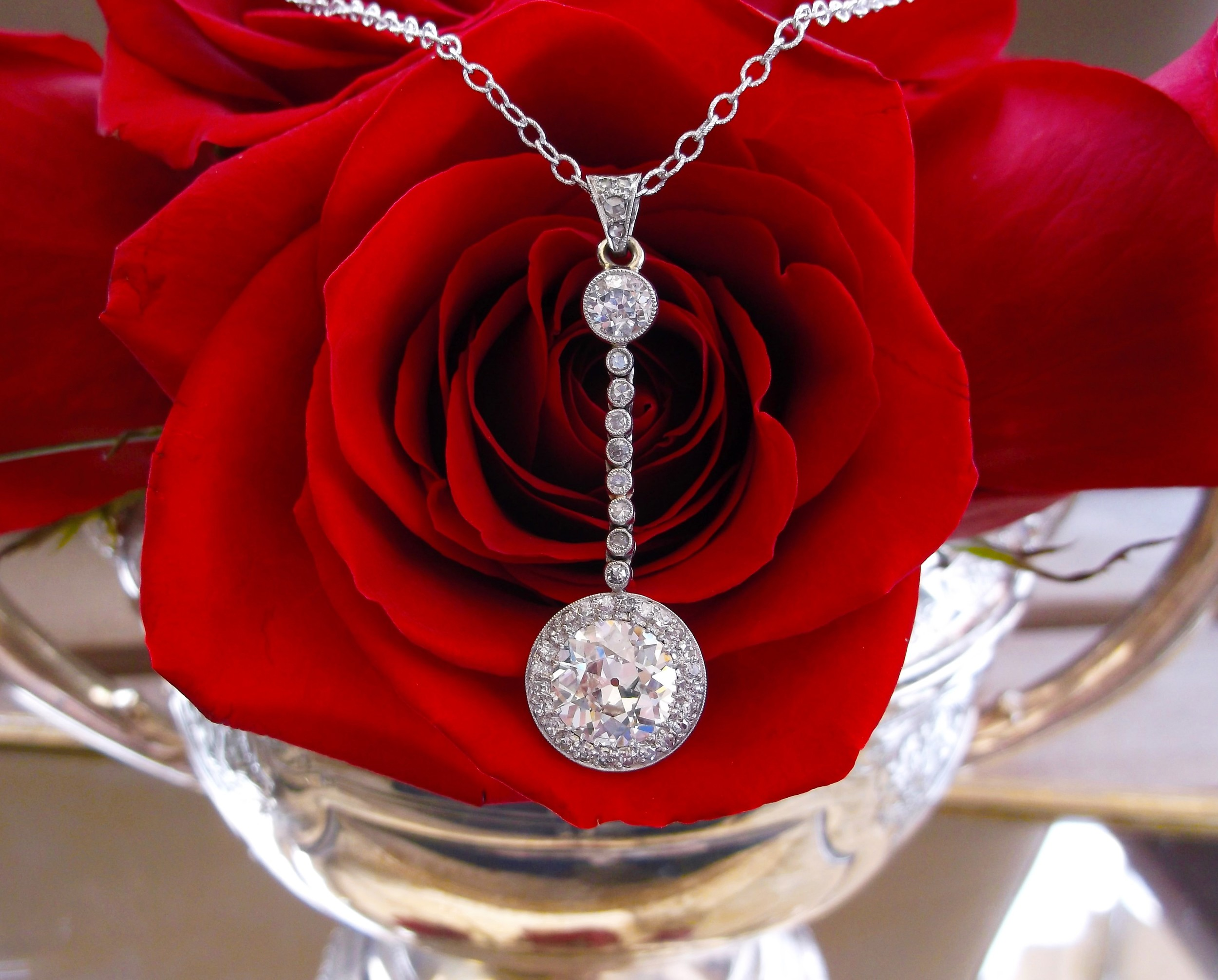 SOLD - Breathtaking 1920's 2.42 carat Old European cut diamond set in a gorgeous platinum and diamond pendant.