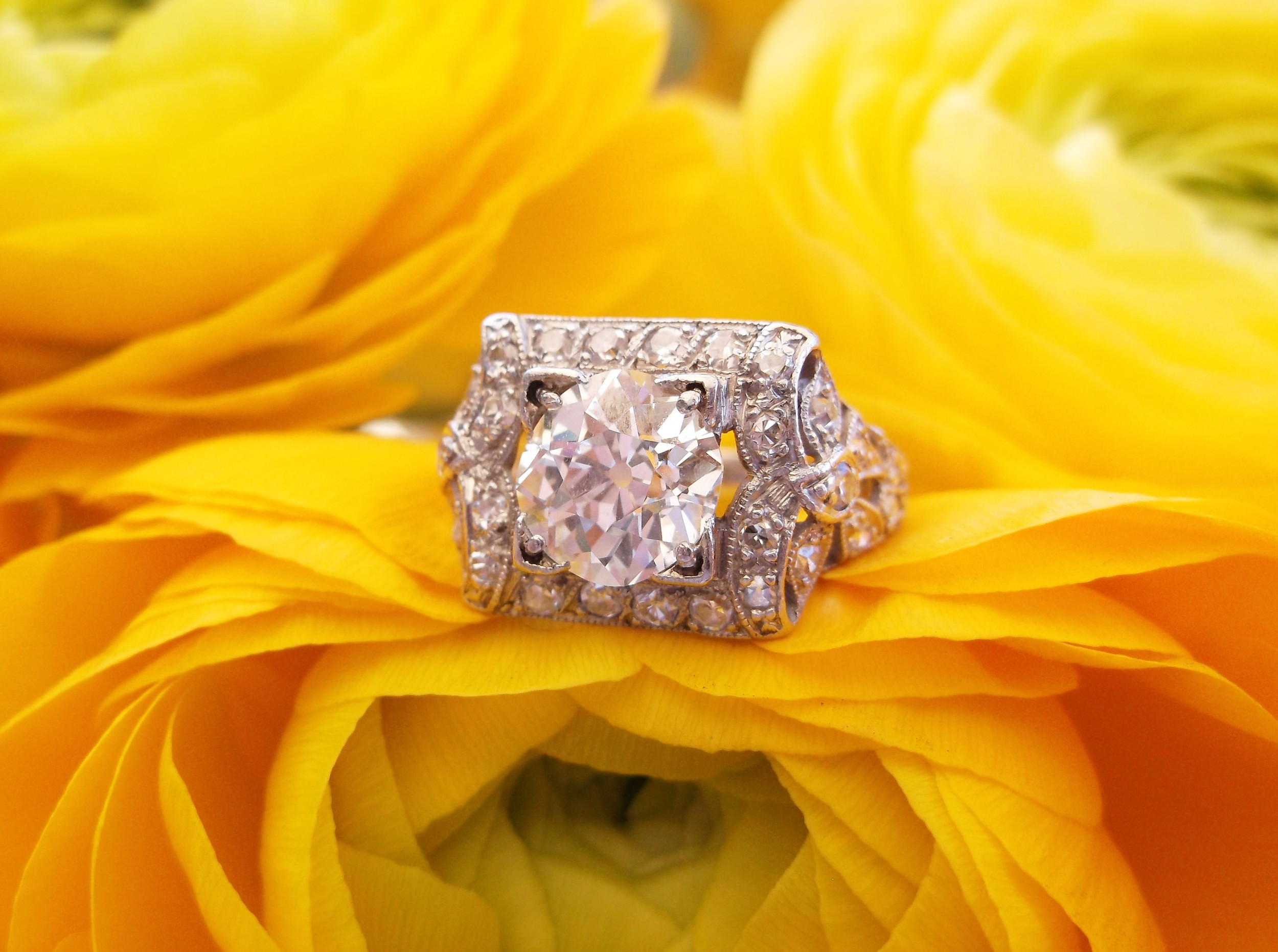 SOLD - Beautifully intricate 1920's 1.46 carat Old European cut diamond set in a platinum and diamond mounting.