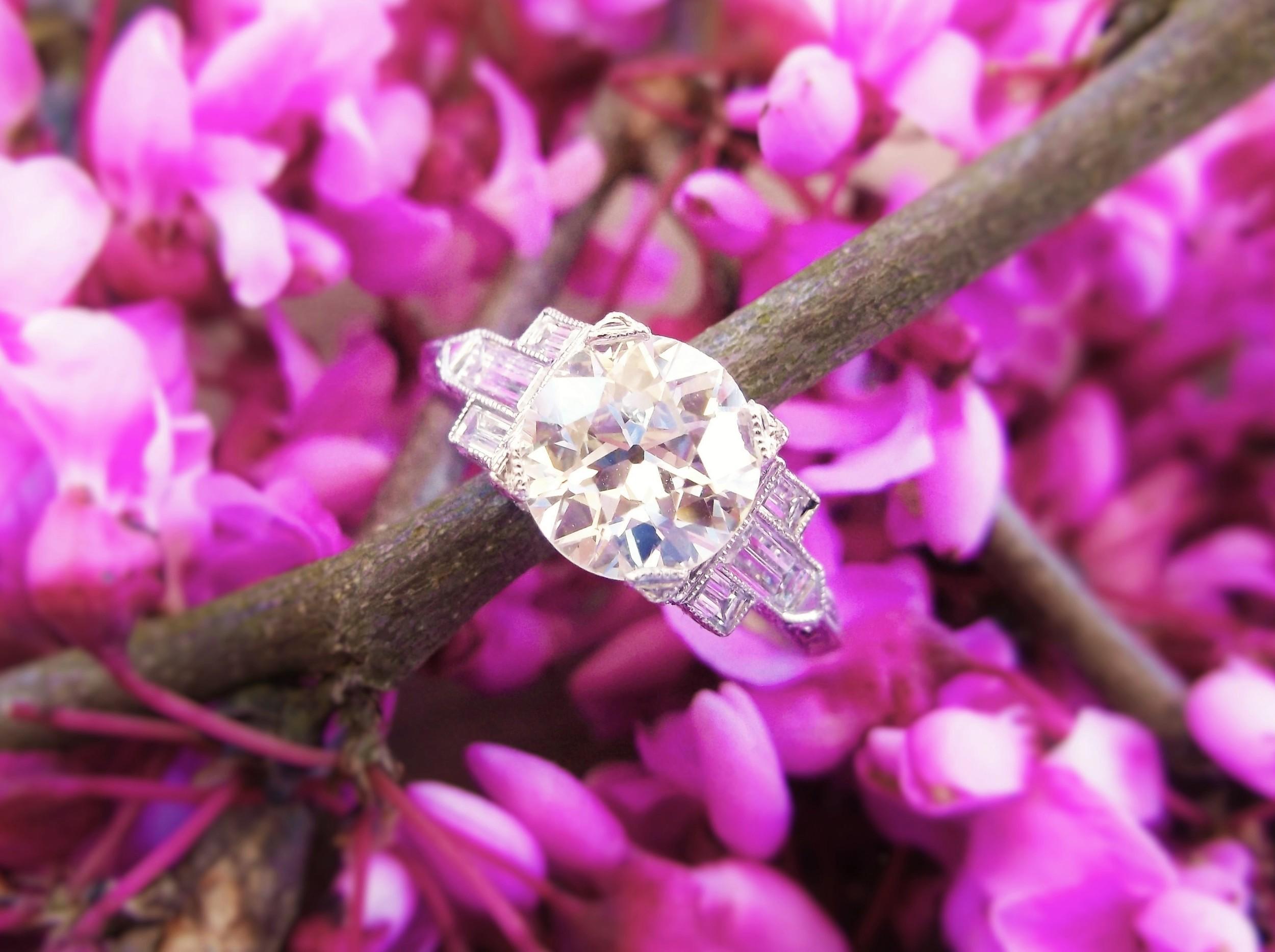 SOLD - Stunning 1.63 carat Old European cut diamond set in a beatiful baguette diamond and platinum mounting.