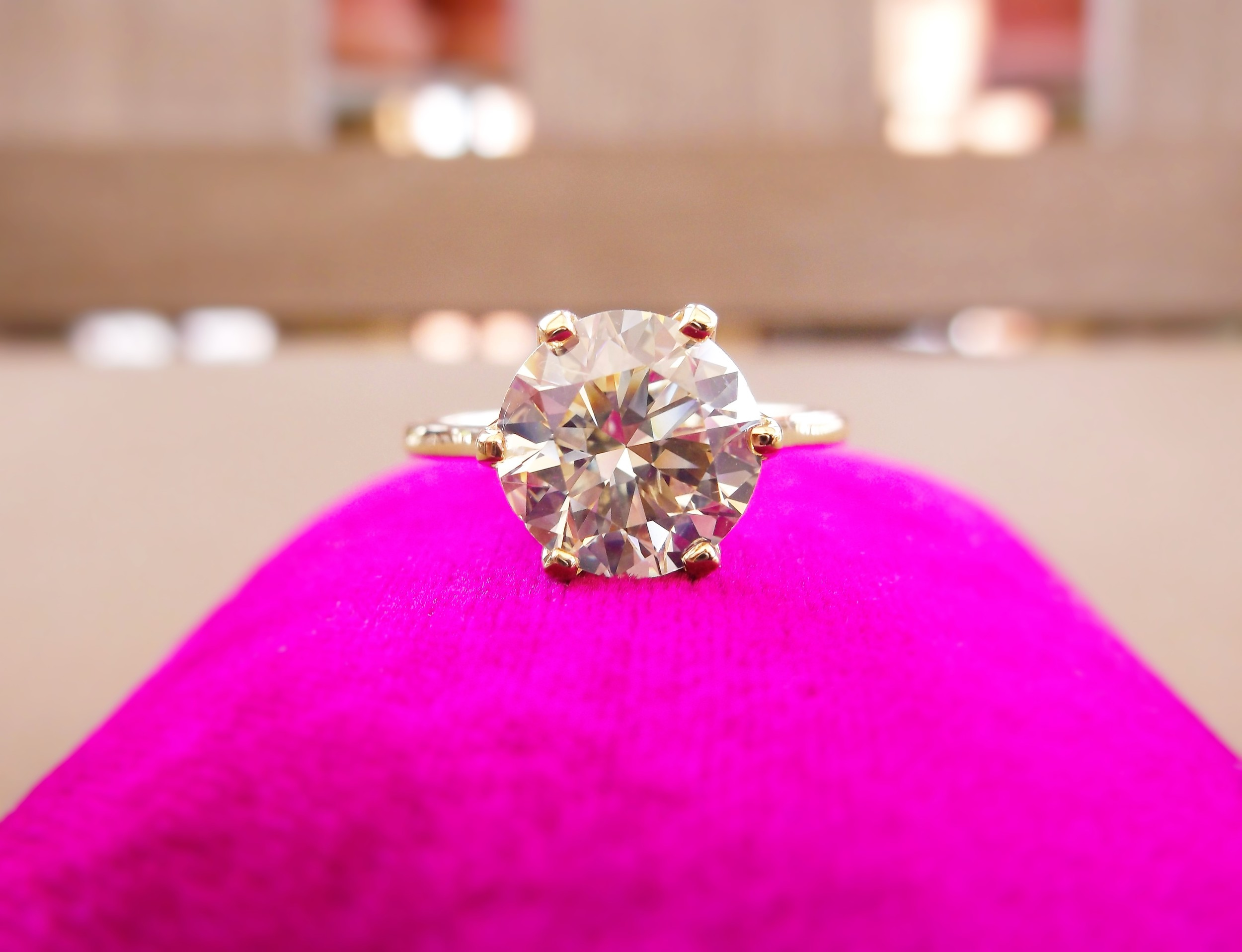 SOLD - Resplendent 3.06 carat transitional cut diamond with a hint of color set in a yellow gold solitaire setting.